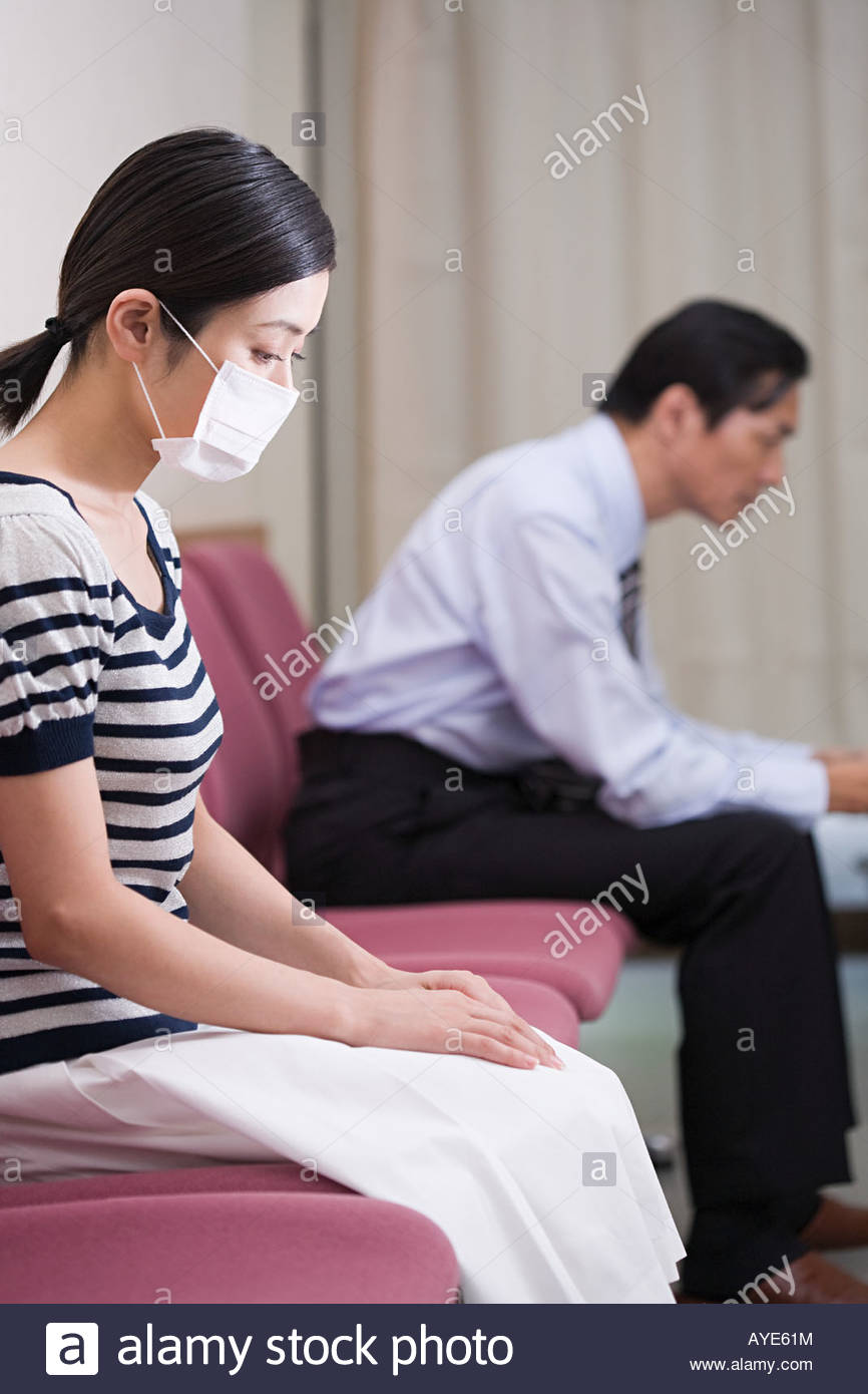 Woman in surgical mask - Stock Image