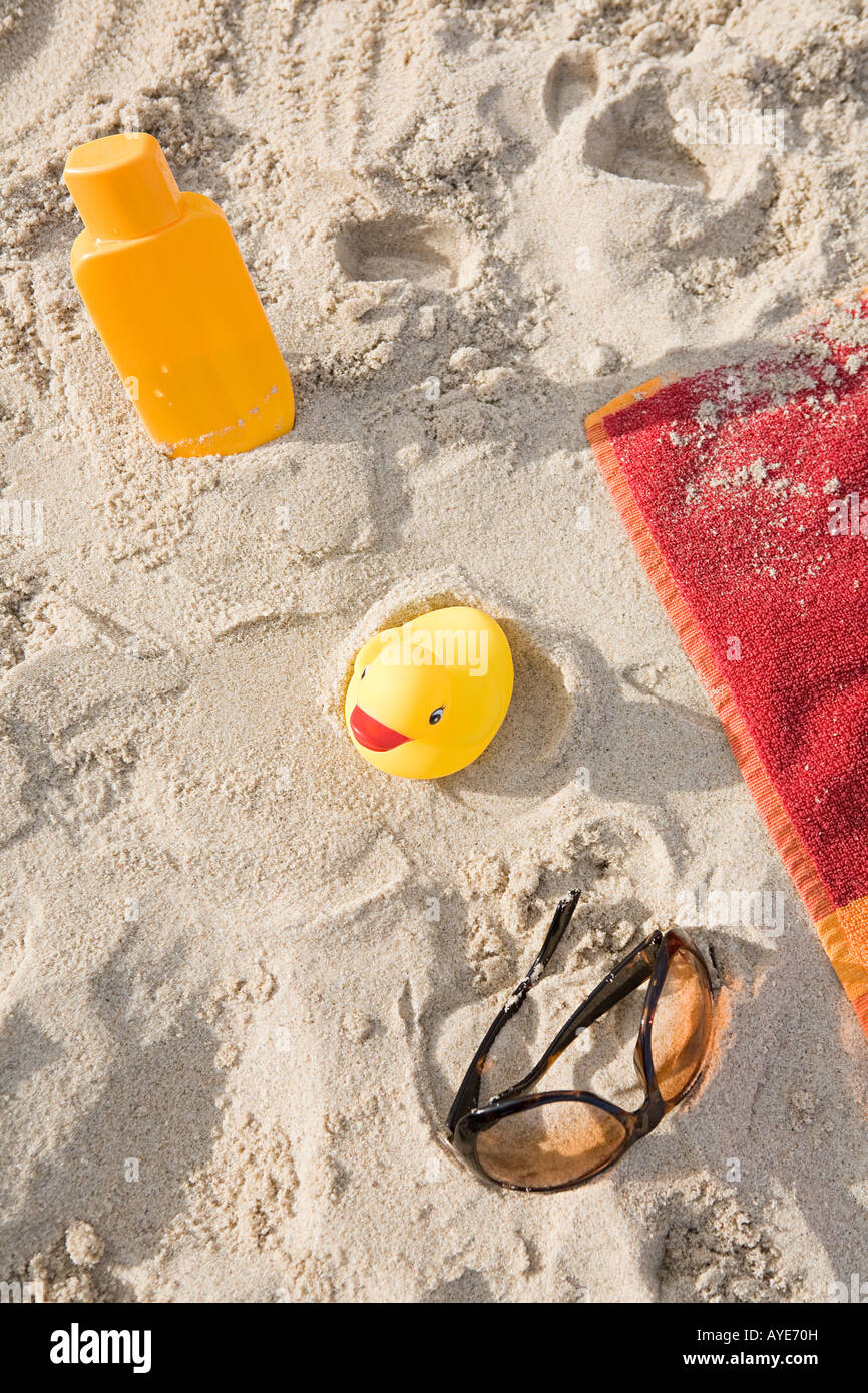 Holiday items on a beach - Stock Image