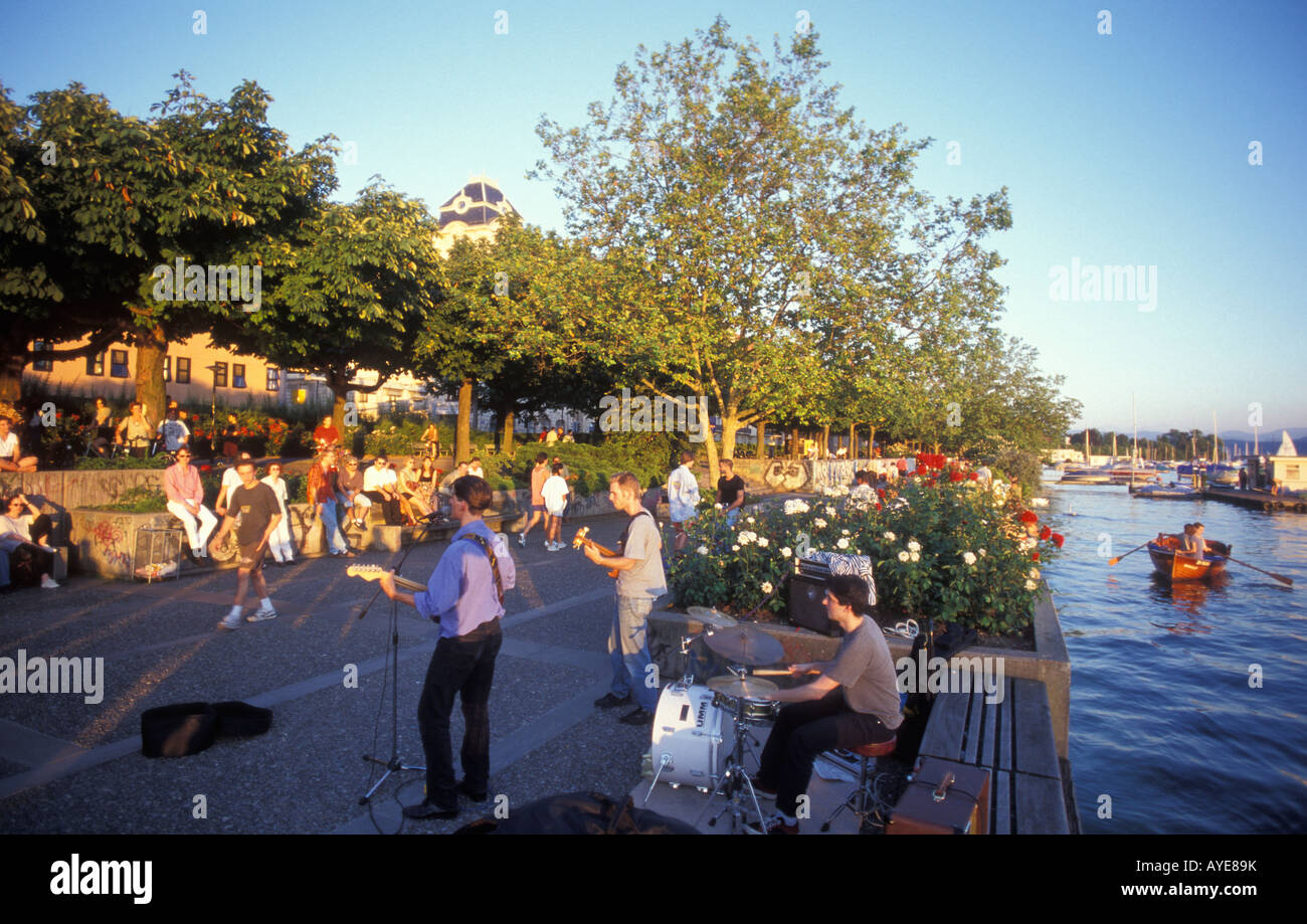 Buskers at the Uto Quai quay close to Zurichsee lake in Zurich Switzerland Stock Photo