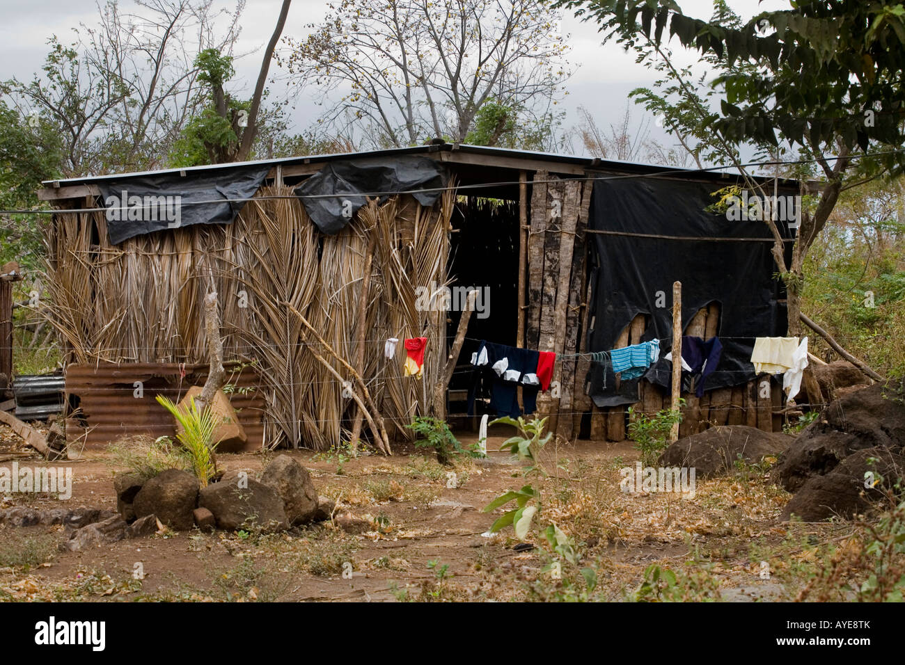 House made mostly of thatch Ometepe Island Nicaragua - Stock Image