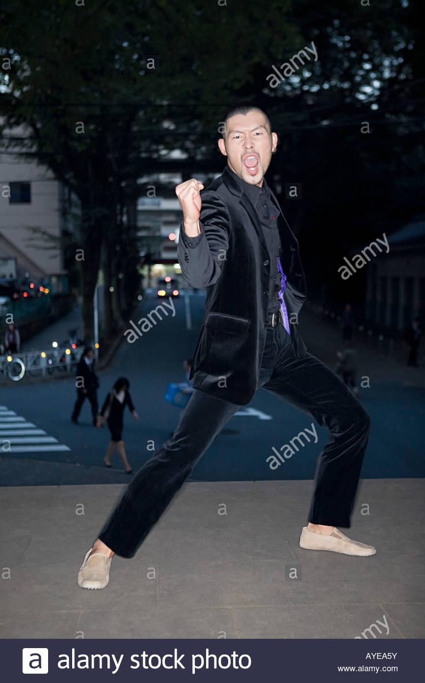 Japanese man celebrating - Stock Image