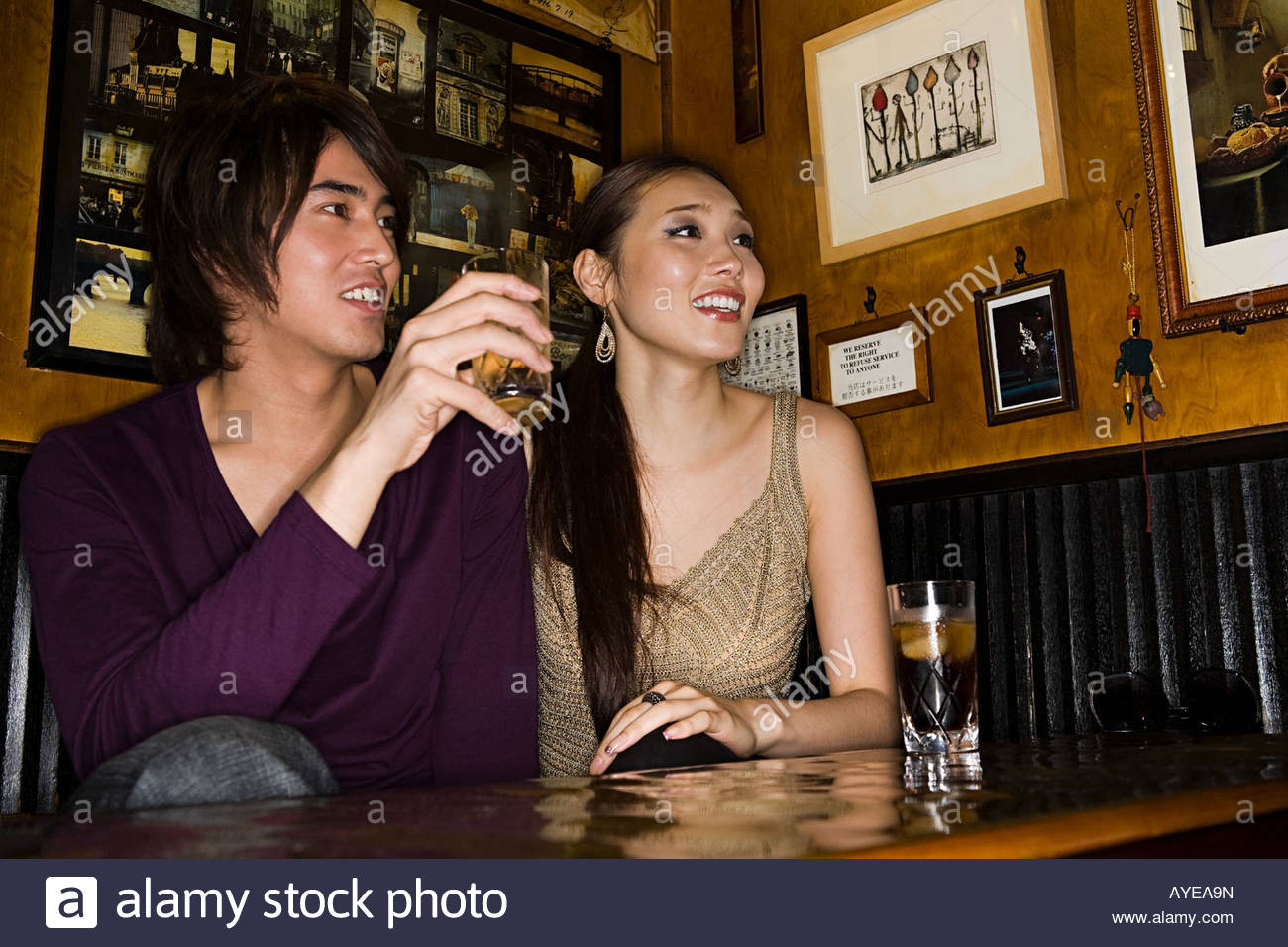 Japanese couple in a bar - Stock Image