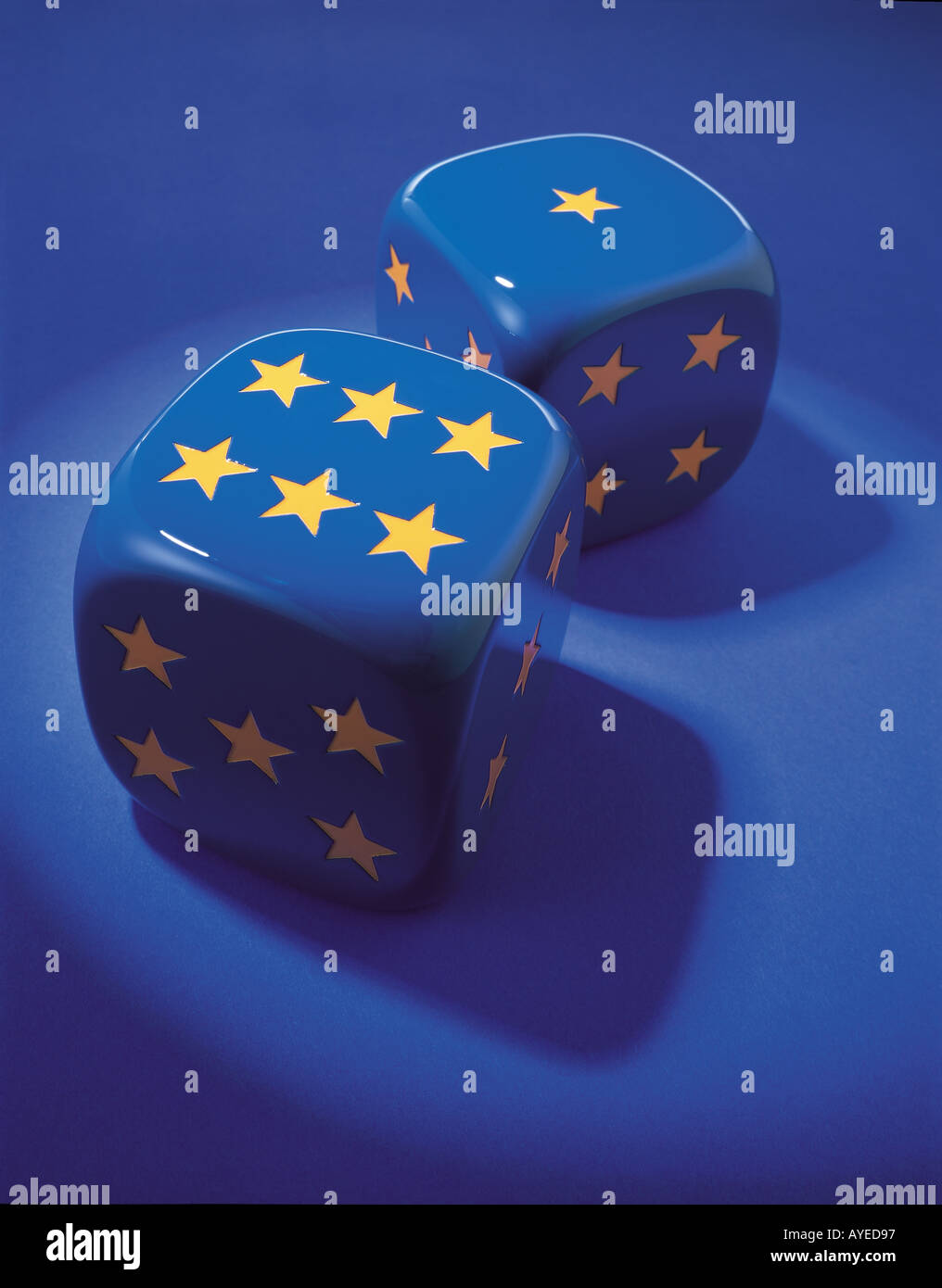 two blue dice with stars for numbers in gold colour like the European Union flag - Stock Image