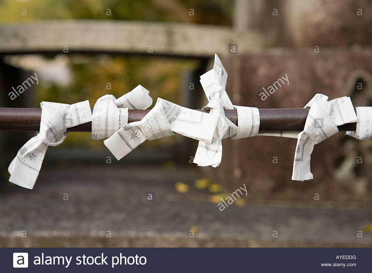 Fortunes tied to a railing - Stock Image