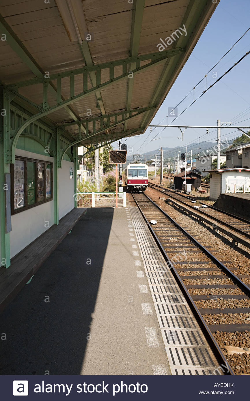 Train arriving at station - Stock Image