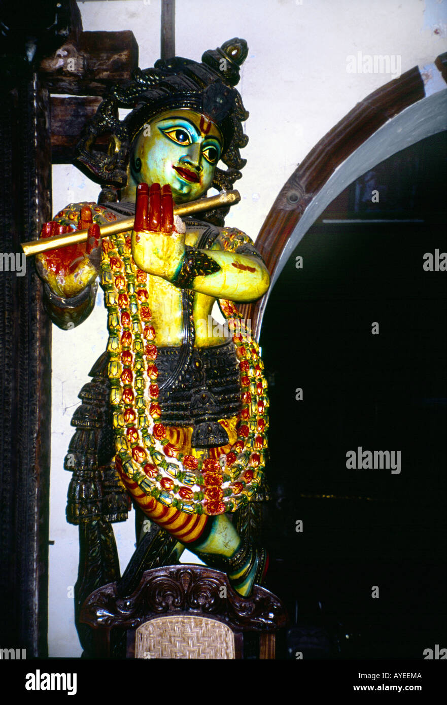Kochi ( Cochin ) Kerala India Wooden Antique Statue of Krishna - Stock Image
