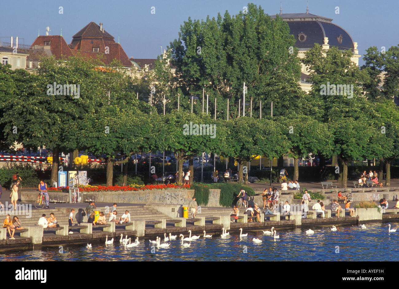 People at the Uto Quai quay close to Zurichsee lake in Zurich Switzerland Stock Photo