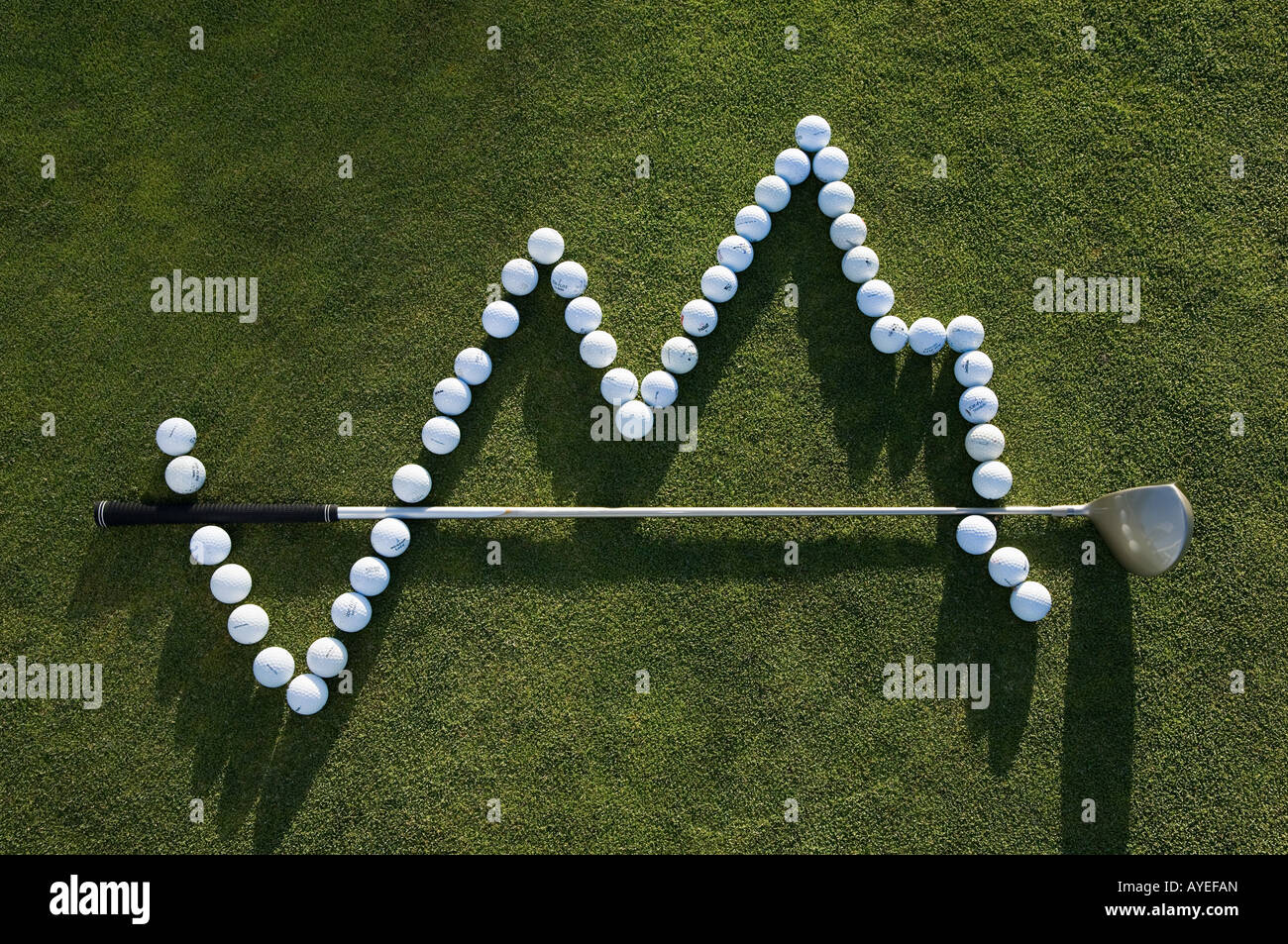 A golf ball and a golf club making a graph - Stock Image