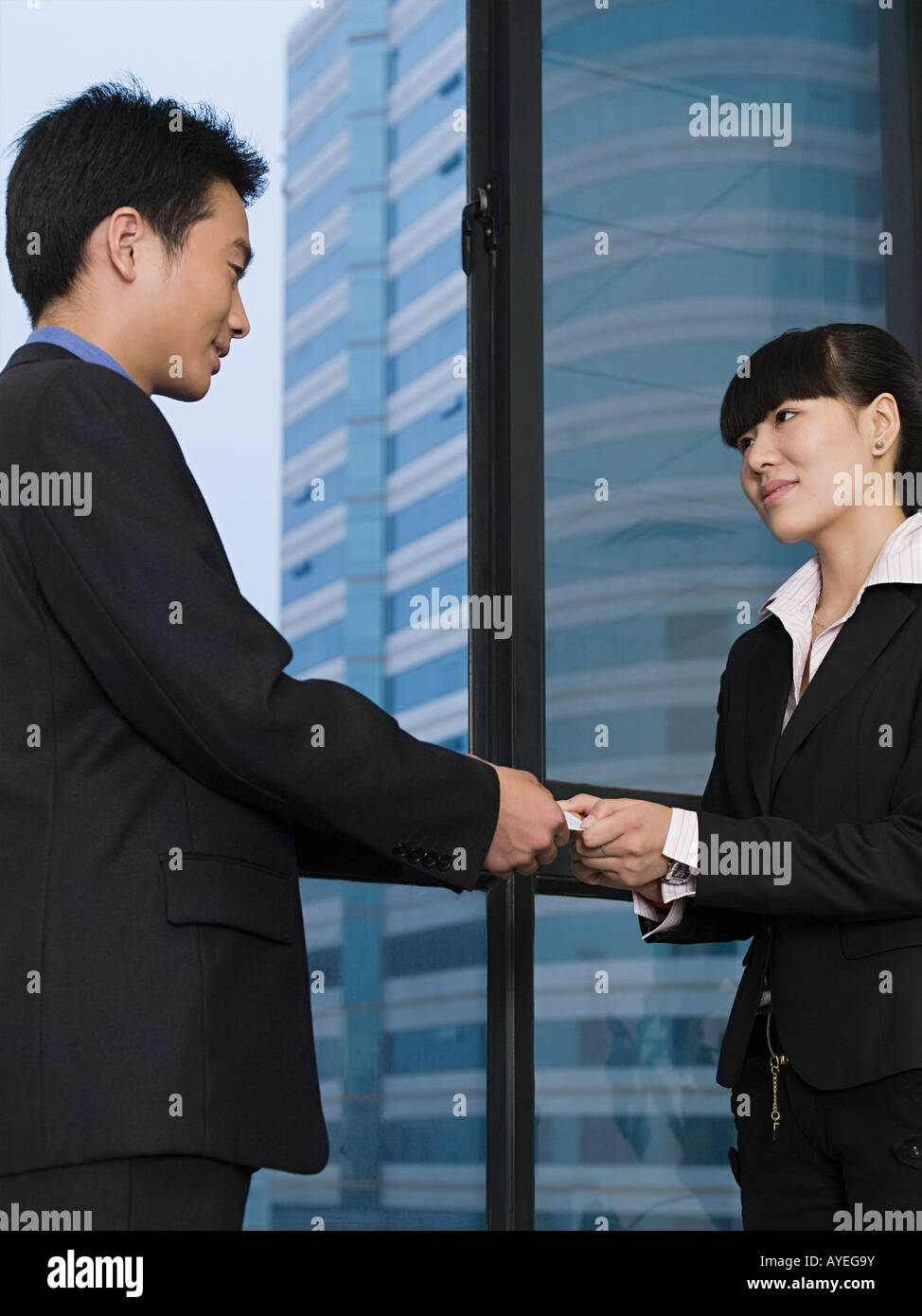 Business people with business card - Stock Image