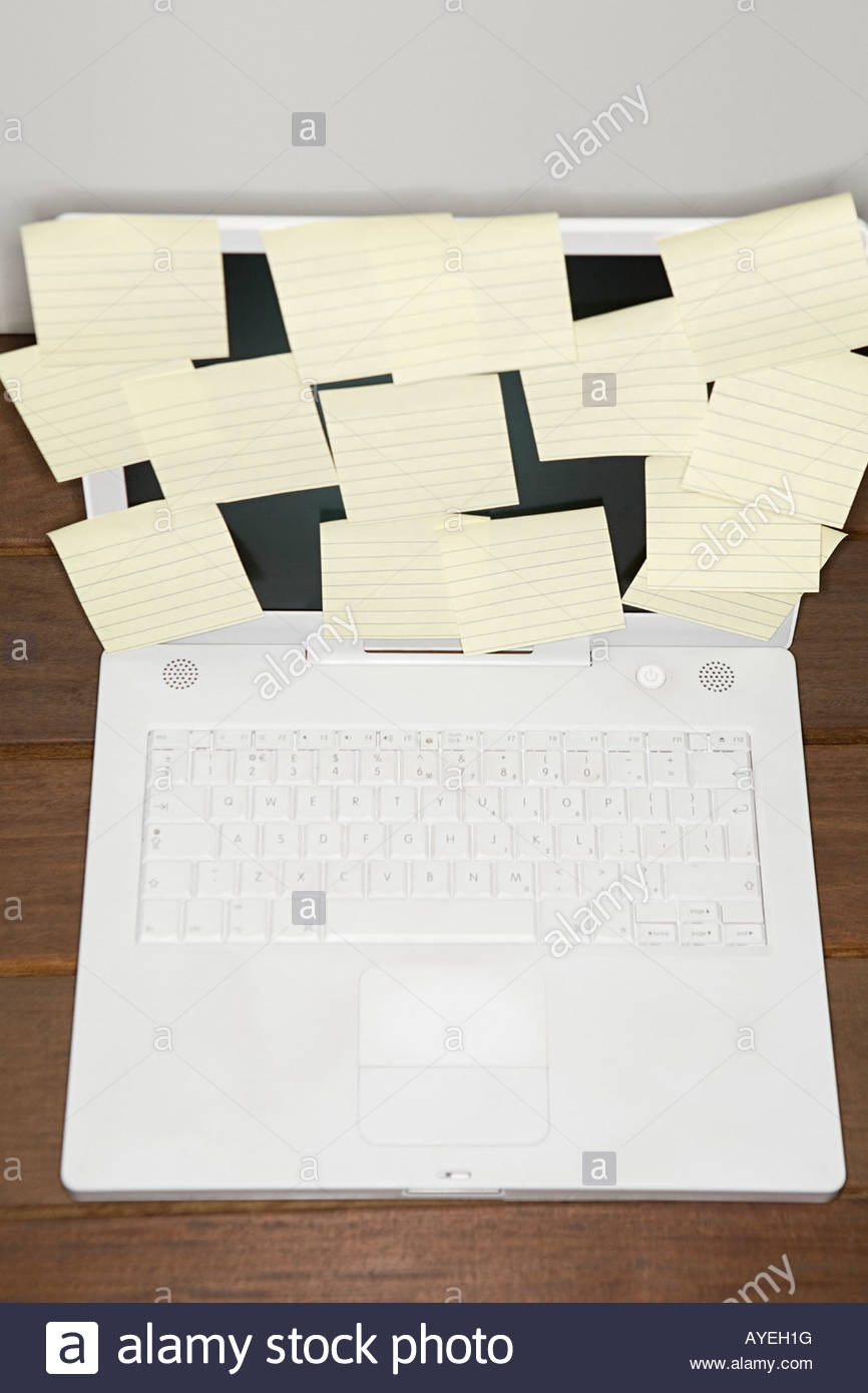Adhesive notes on a laptop - Stock Image