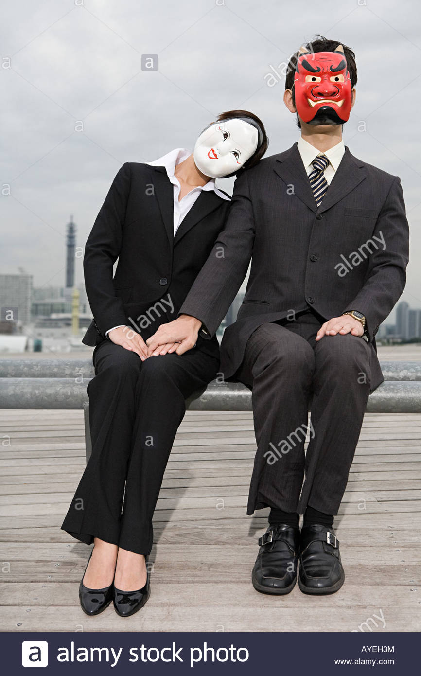 Businesspeople wearing masks - Stock Image