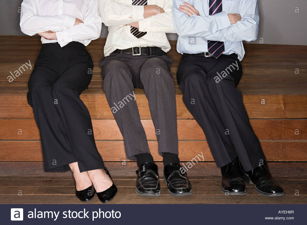 Businesspeople with crossed arms - Stock Image