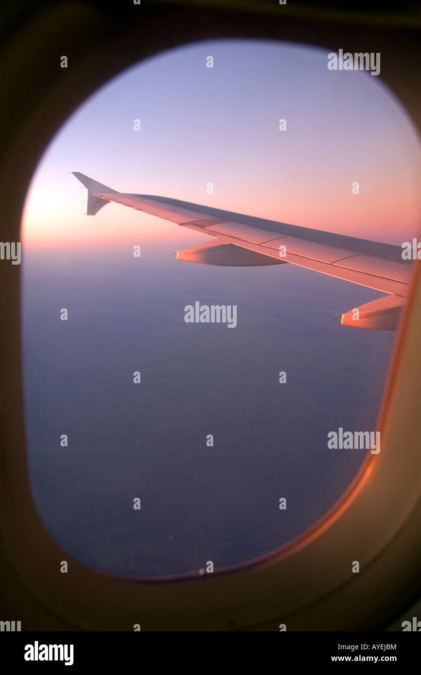 Aerial view of the Andes in Argentina at sunrise through the window of an airplane - Stock Image