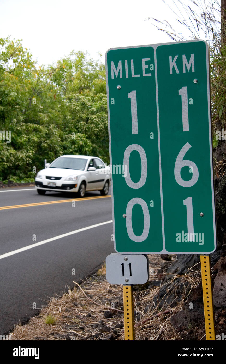 Roadside mile marker showing measurement in miles and kilometers on the Big Island of Hawaii - Stock Image