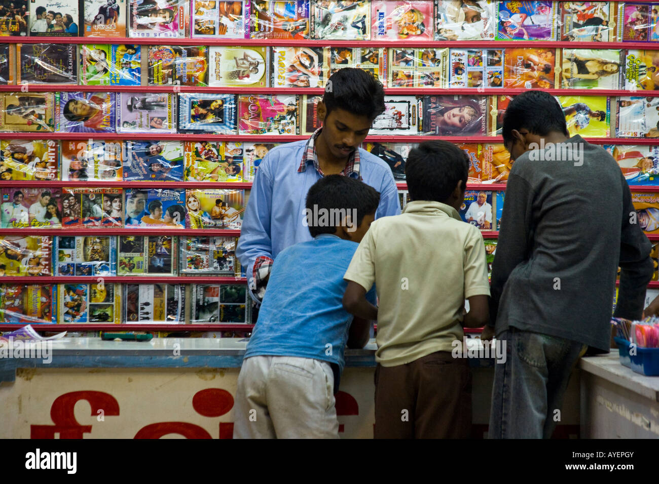 20b6531be Boys Shopping for DVD Movies and Music at a Shop in Thanjavur South India
