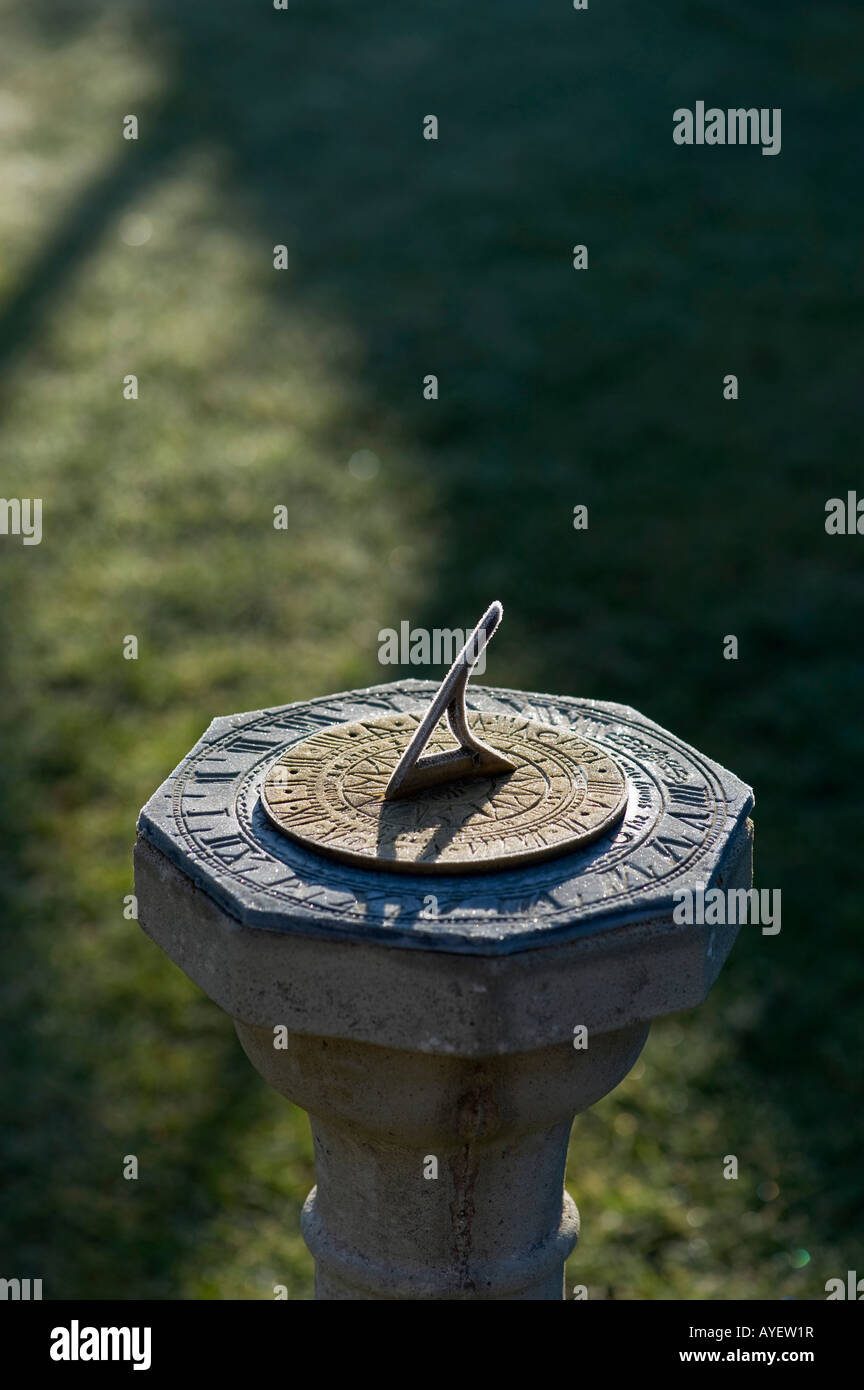 Frost covered Garden sun dial - Stock Image