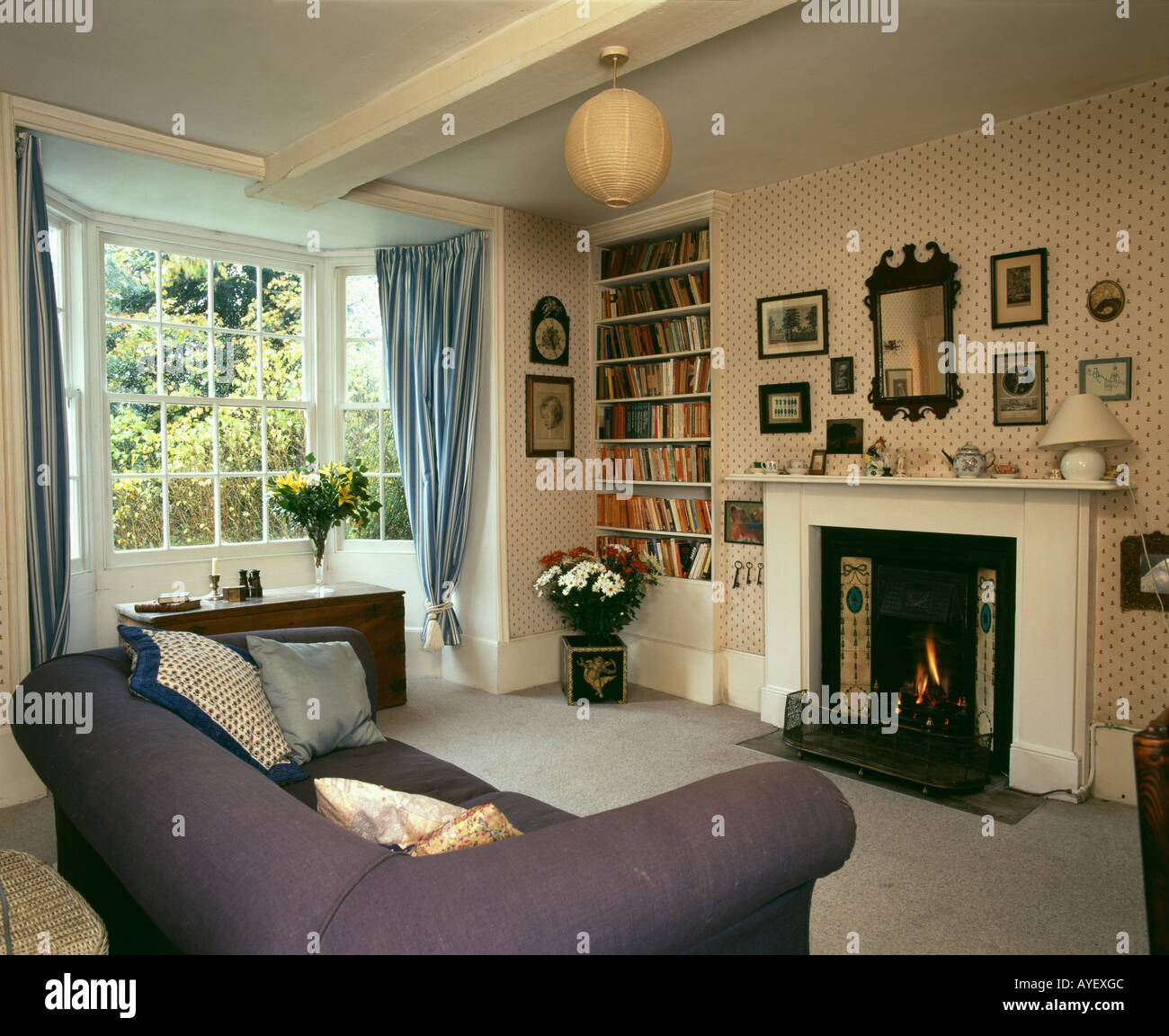 . Country livingroom with fireplace and ornaments suspended from Stock