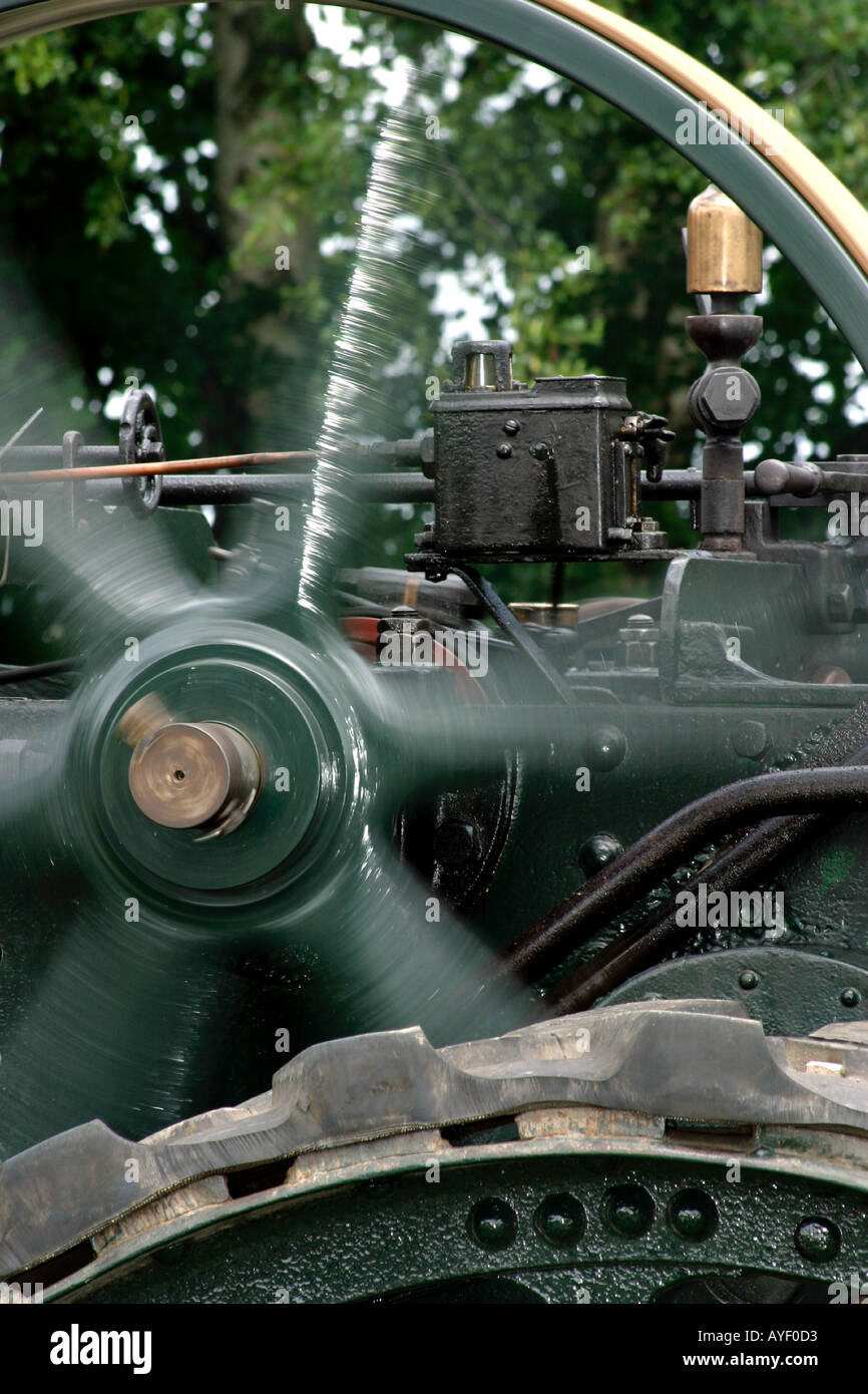 Detail of traction engine under steam with flywheel rotating - Stock Image