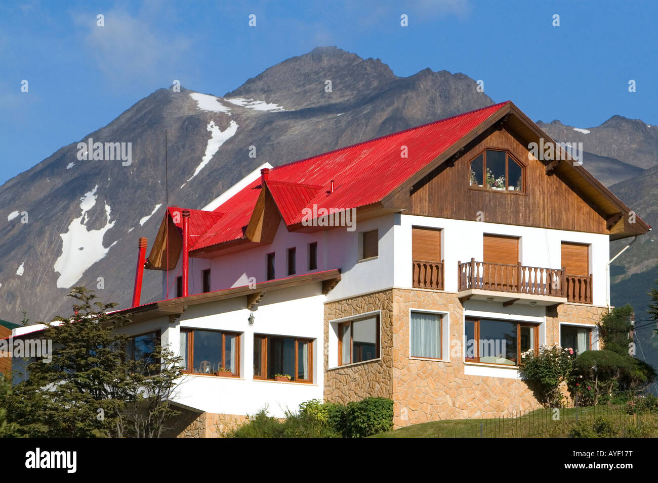 Chalet style house below the Martial mountain range at Ushuaia Tierra del Fuego Argentina - Stock Image