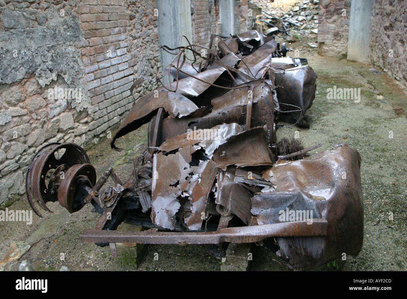 Car remains at Oradour sur Glane preserved Limousin village scene of WW2 Nazi SS massacre France - Stock Image