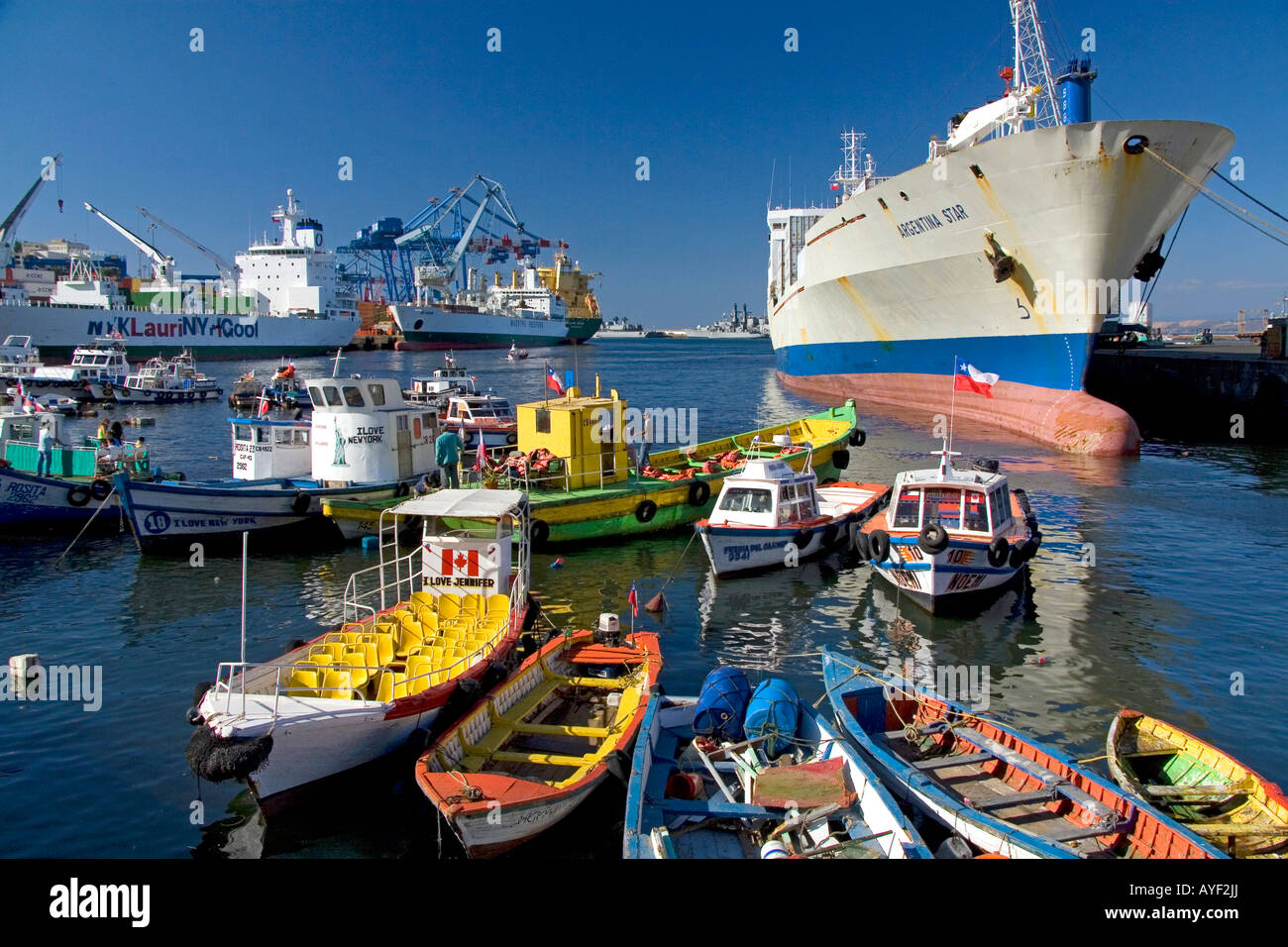 Container ships and small boats in the Port at Valparaiso Chile - Stock Image