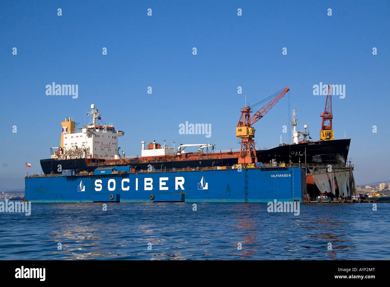 Floating dry dock with container ship in the Port at Valparaiso Chile - Stock Image