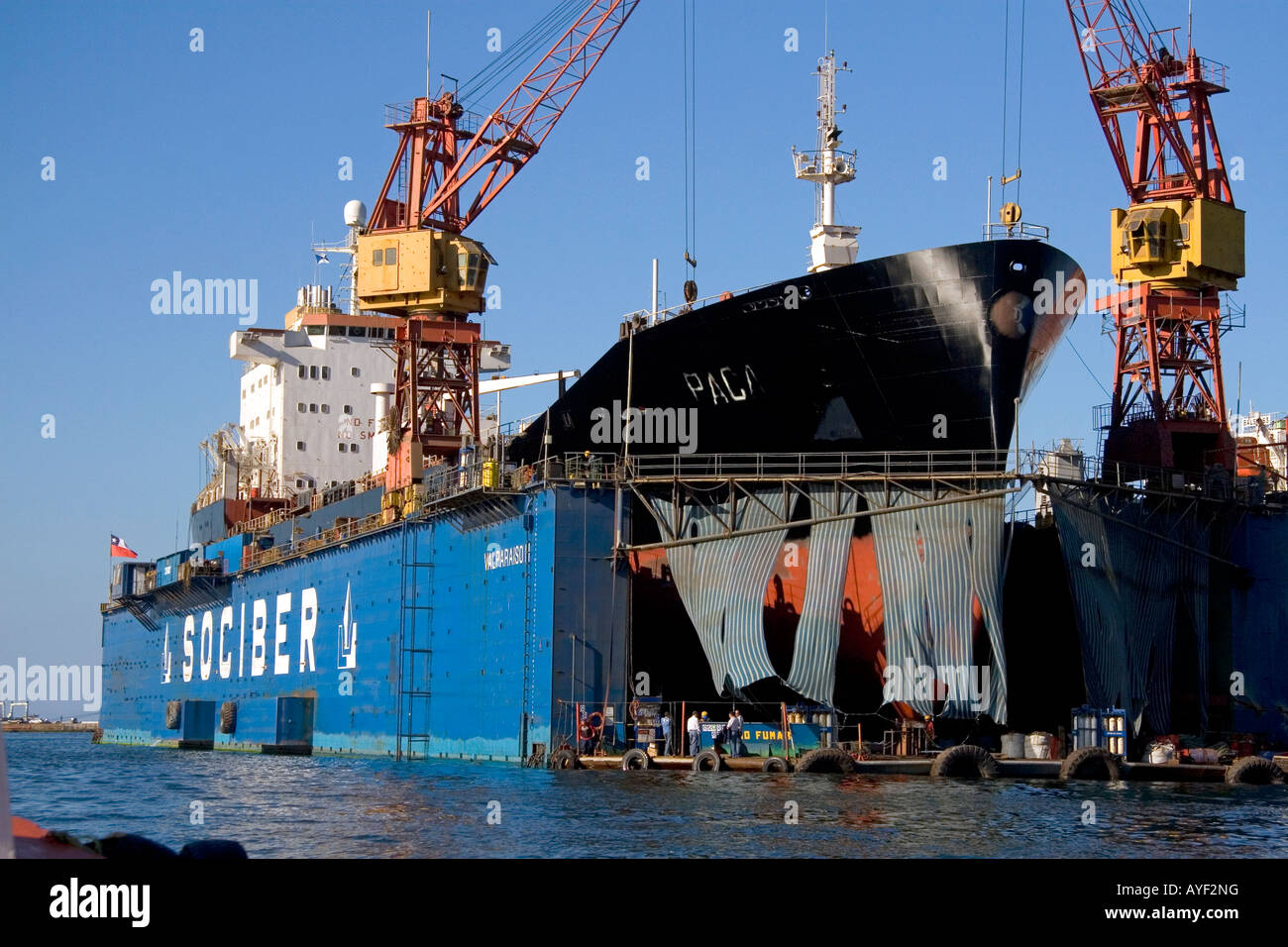 Floating dry dock with container ship in the Port at Valparaiso Chile Stock Photo