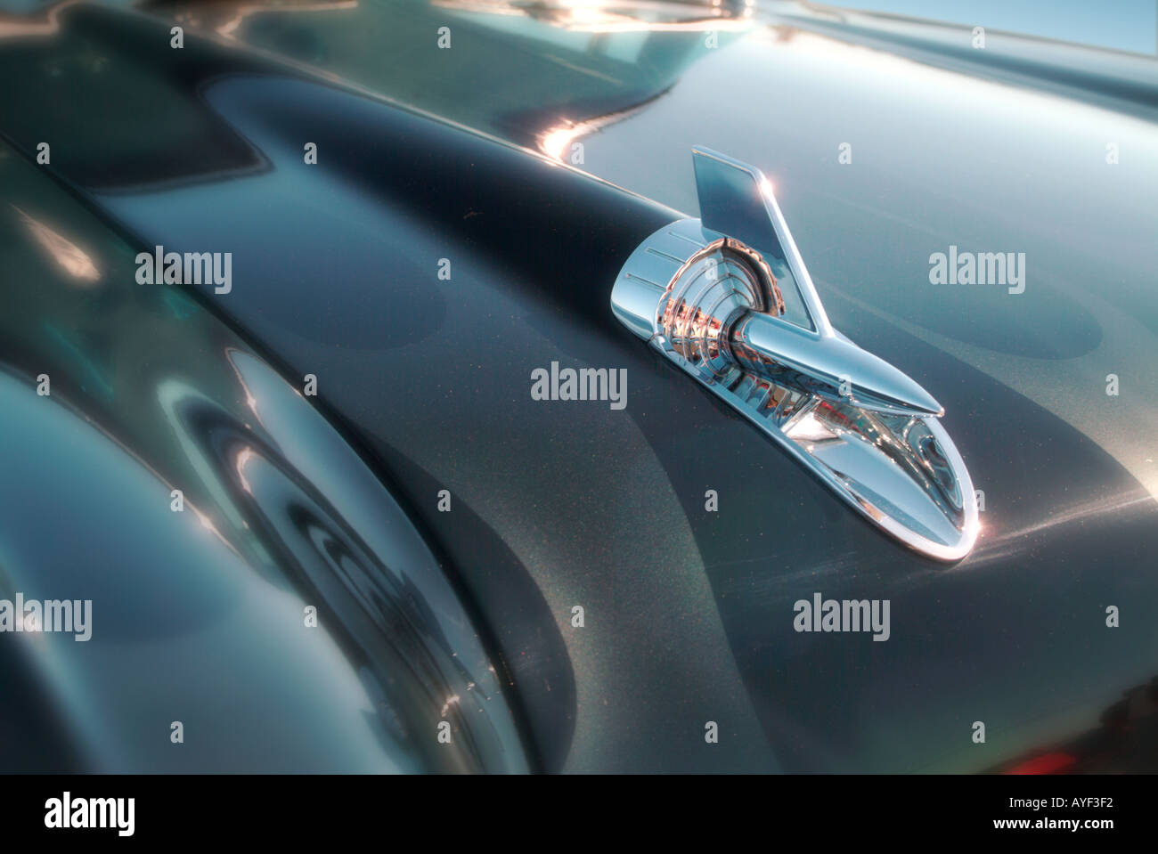 A rocket shaped hood detail on a 57 Chevy Belair - Stock Image