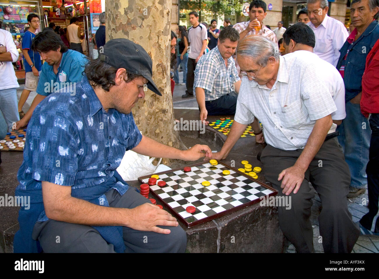 Chilean men play checkers in the Plaza de Armas in Santiago Chile - Stock Image
