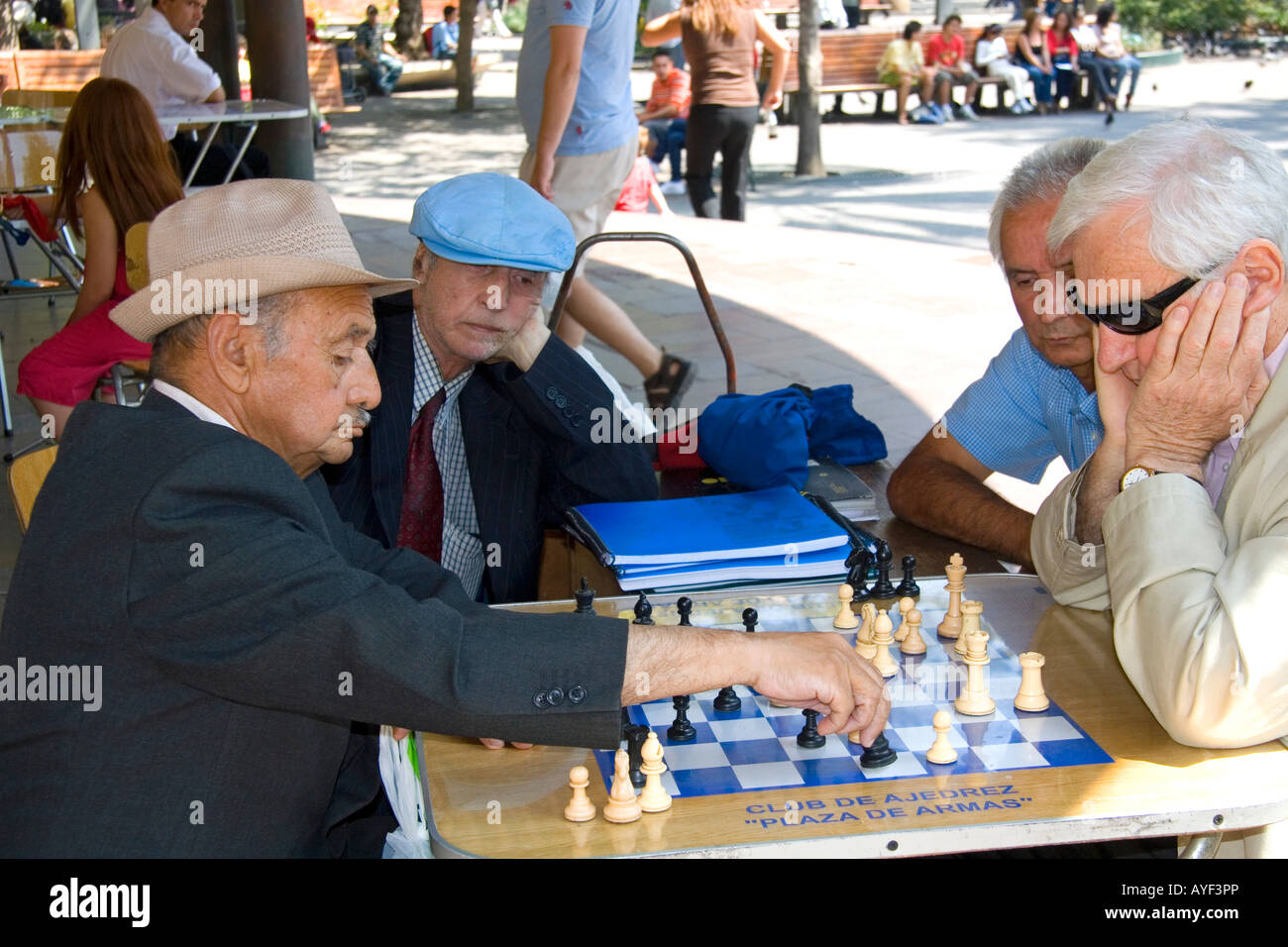 Chilean men play chess in the Plaza de Armas in Santiago Chile - Stock Image