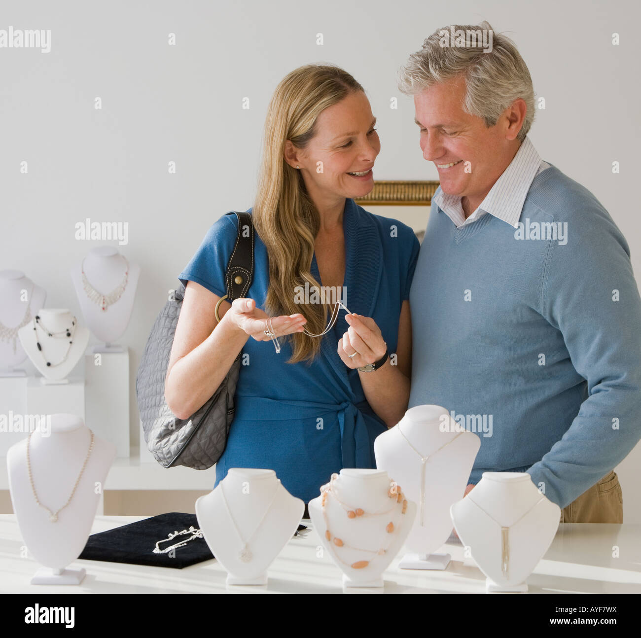Couple shopping for jewelry - Stock Image