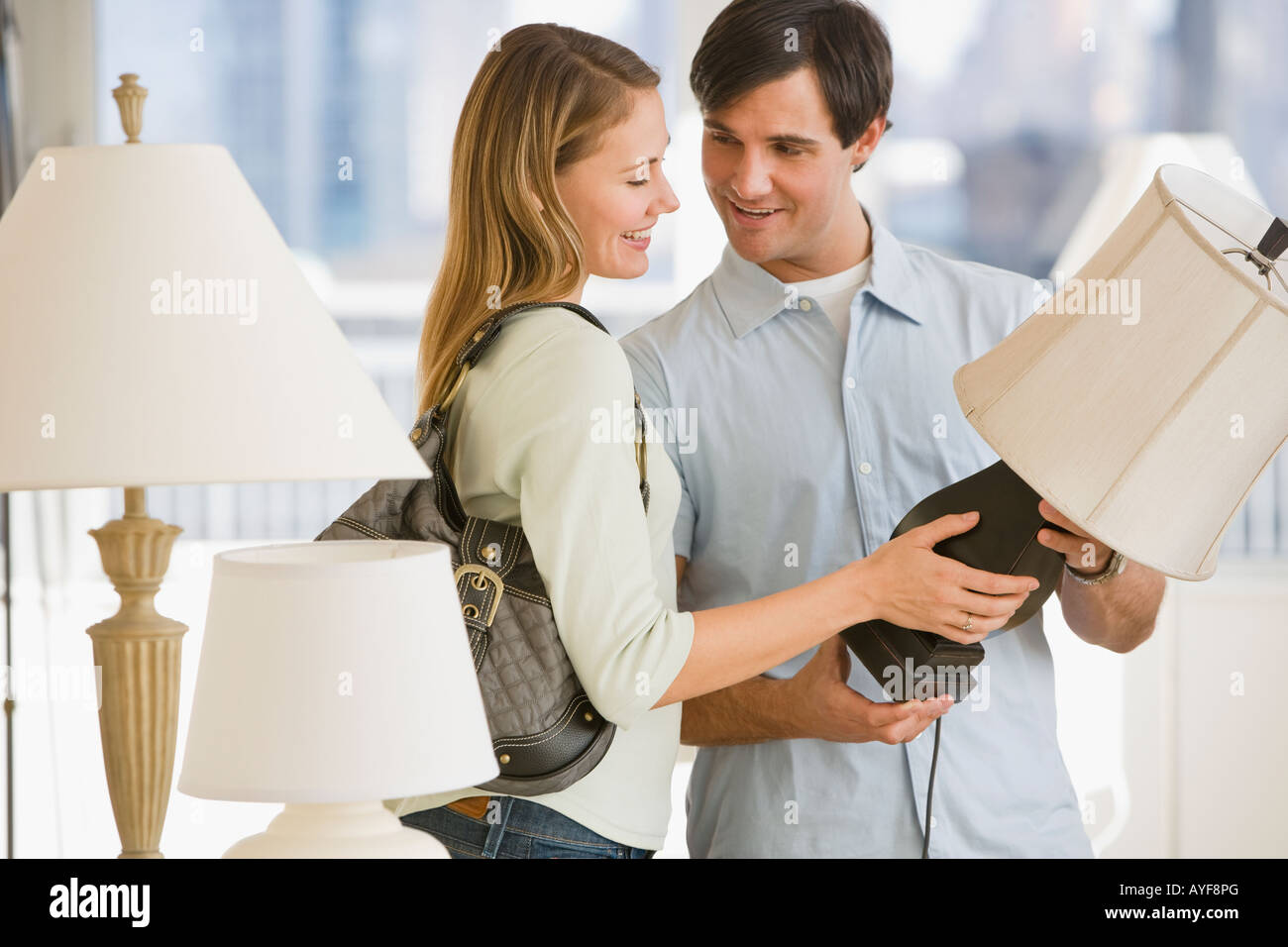 Couple shopping for lighting - Stock Image