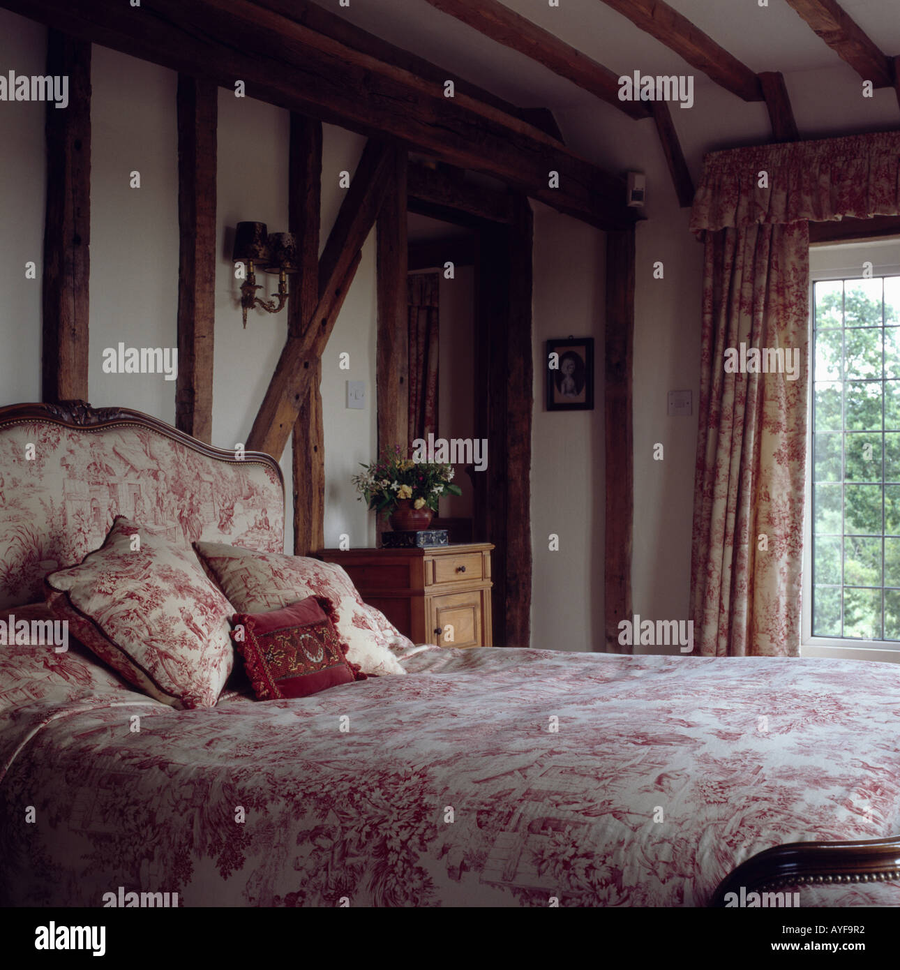 Pink Bedroom With Beamed Walls And Bed With Upholstered Headboard And Stock Photo Alamy