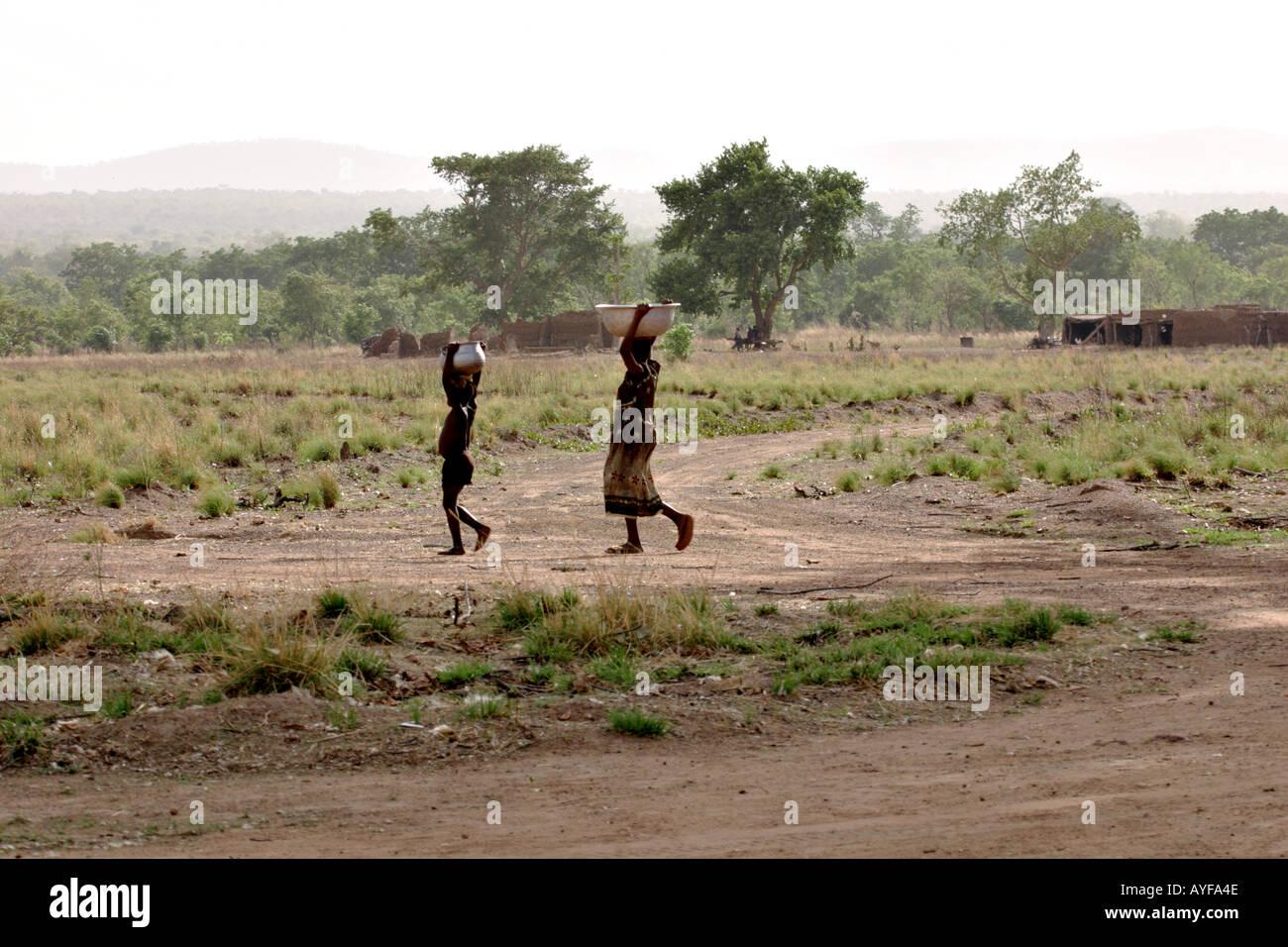 Children fetch water Wechiau Northwestern Ghana - Stock Image