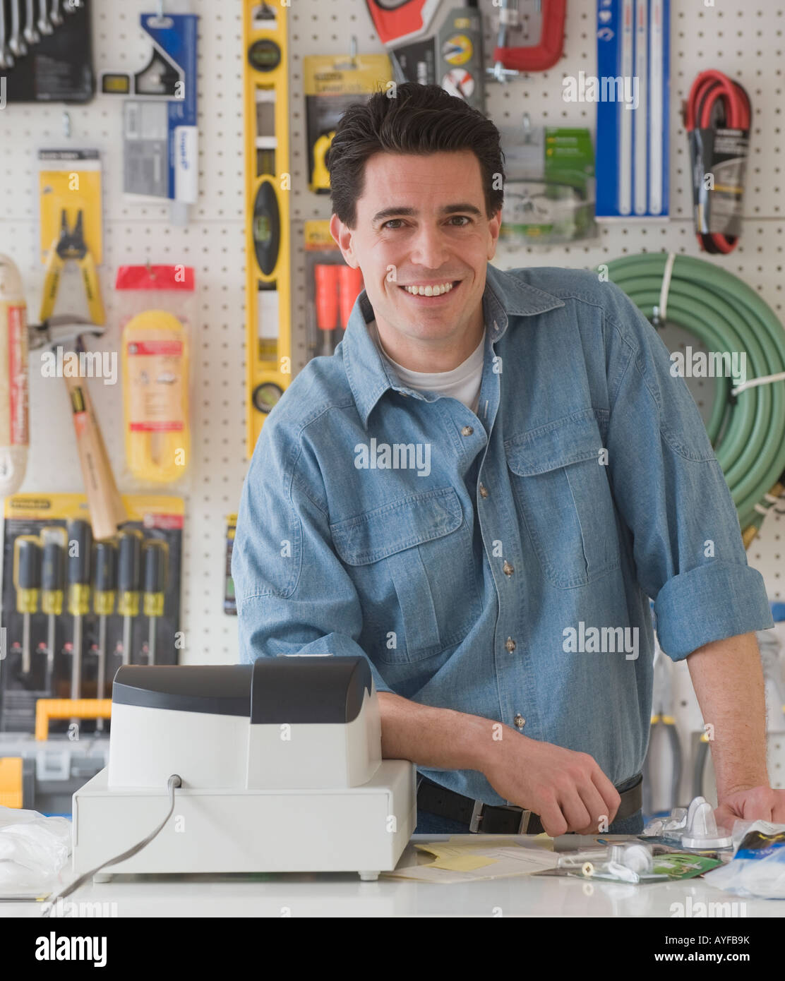 Sales clerk, counter at hardware store - Stock Image
