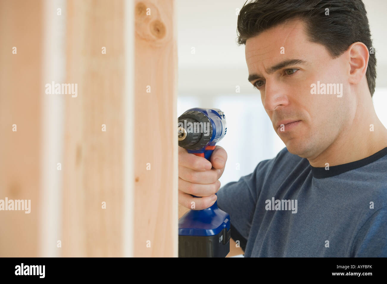 Man using cordless drill - Stock Image