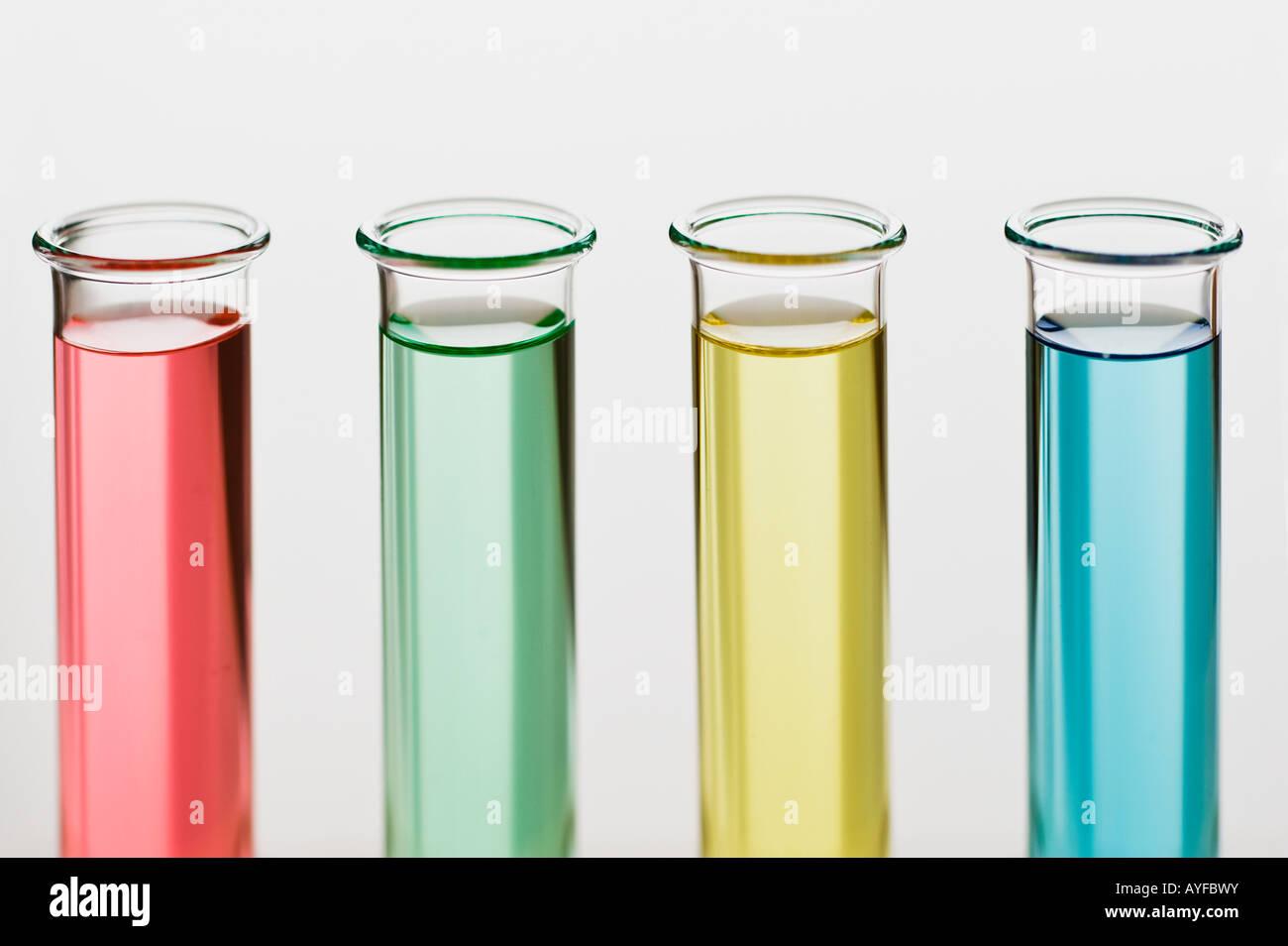 Multi-colored liquids in vials - Stock Image