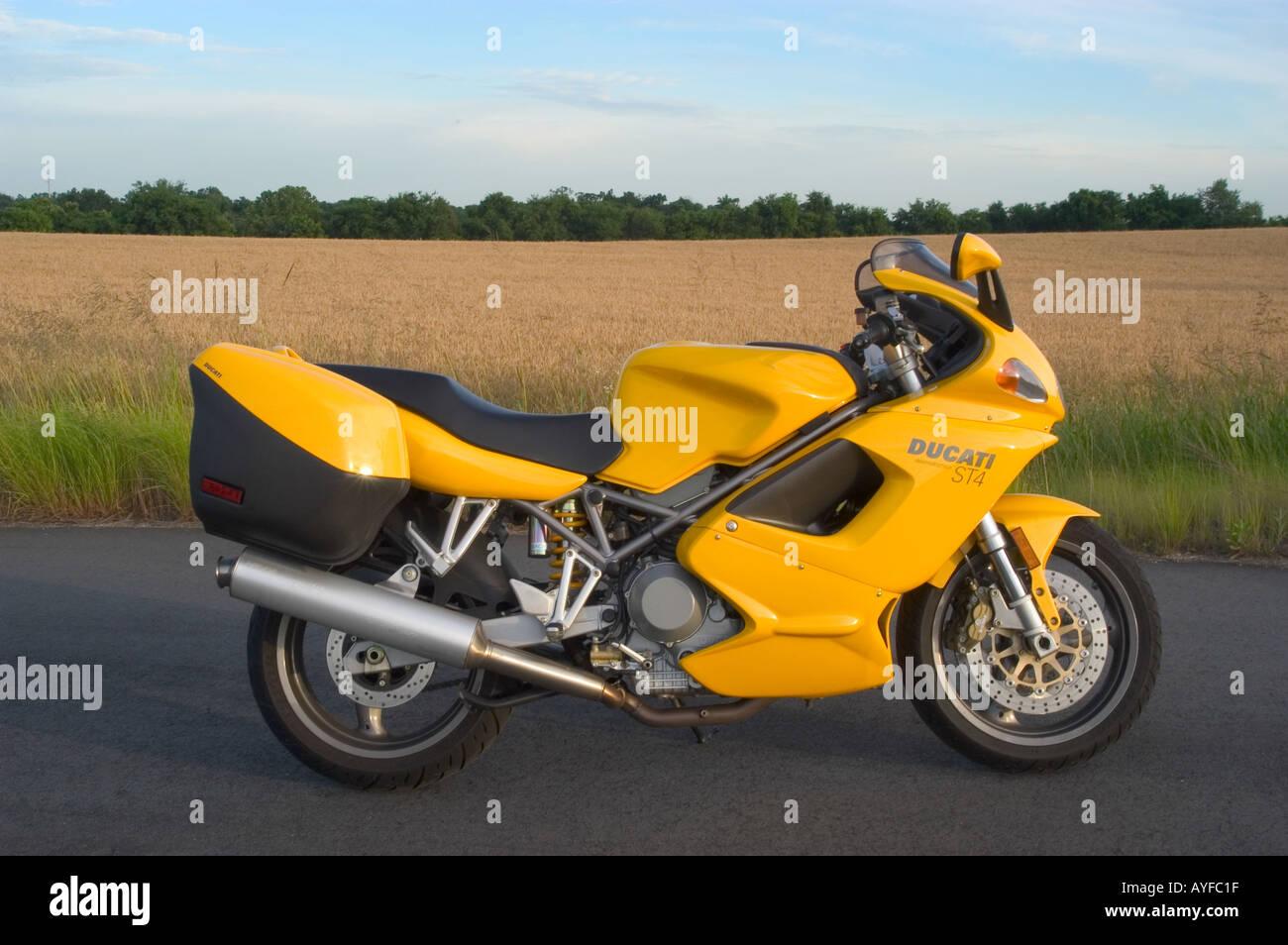 Ducati Motorcycle near Grain Field - Stock Image