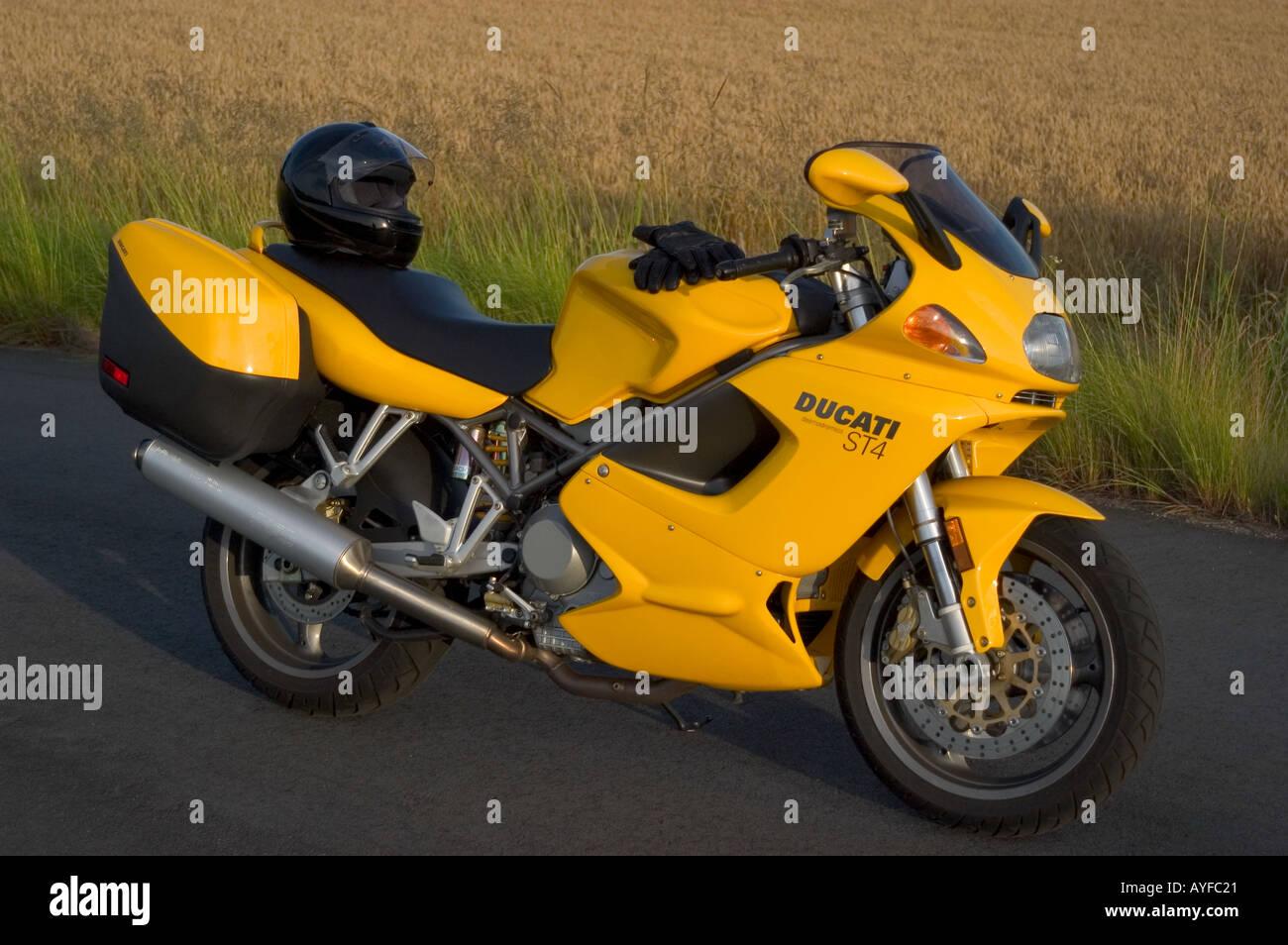 Ducati Motorcycle and Helmet - Stock Image