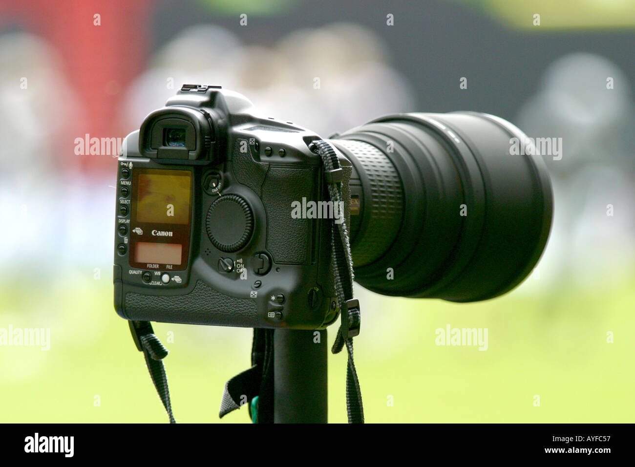 Digital SLR camera on monpod at sports event - Stock Image