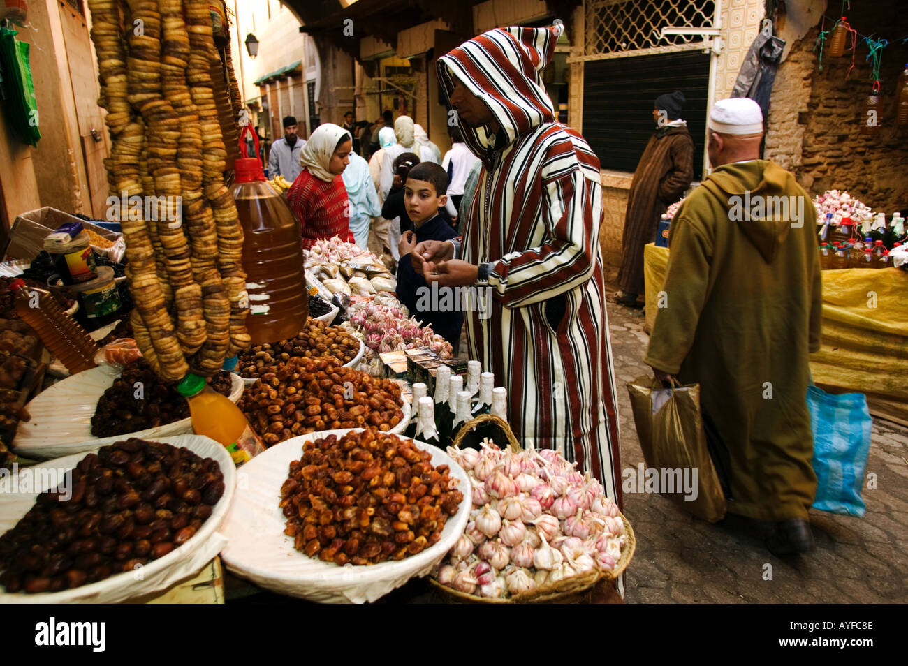 Muslim man dressed in traditional Jellaba shops in the colourful