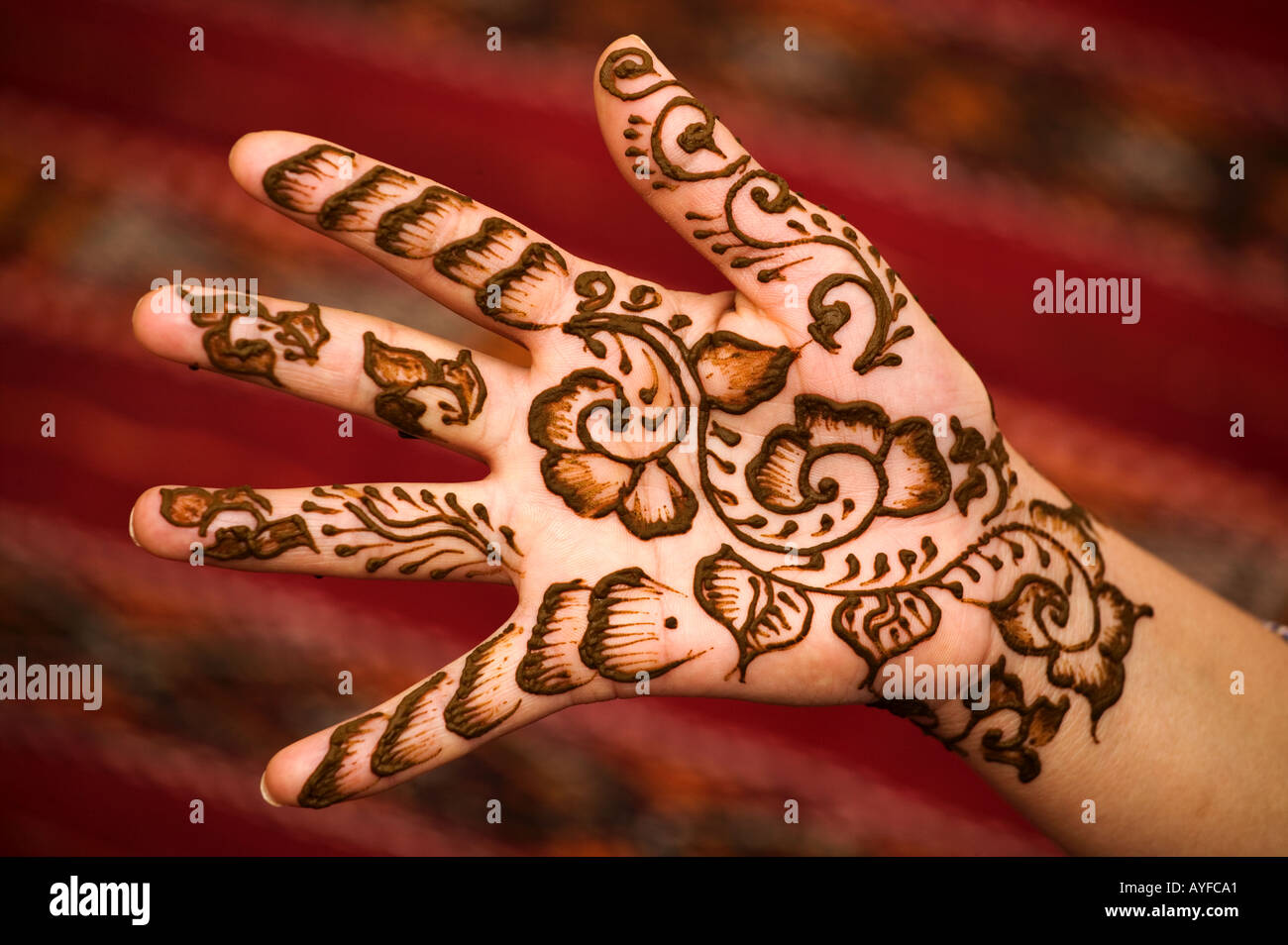 Henna is used to decorate womans hands and feet Model released Morocco - Stock Image