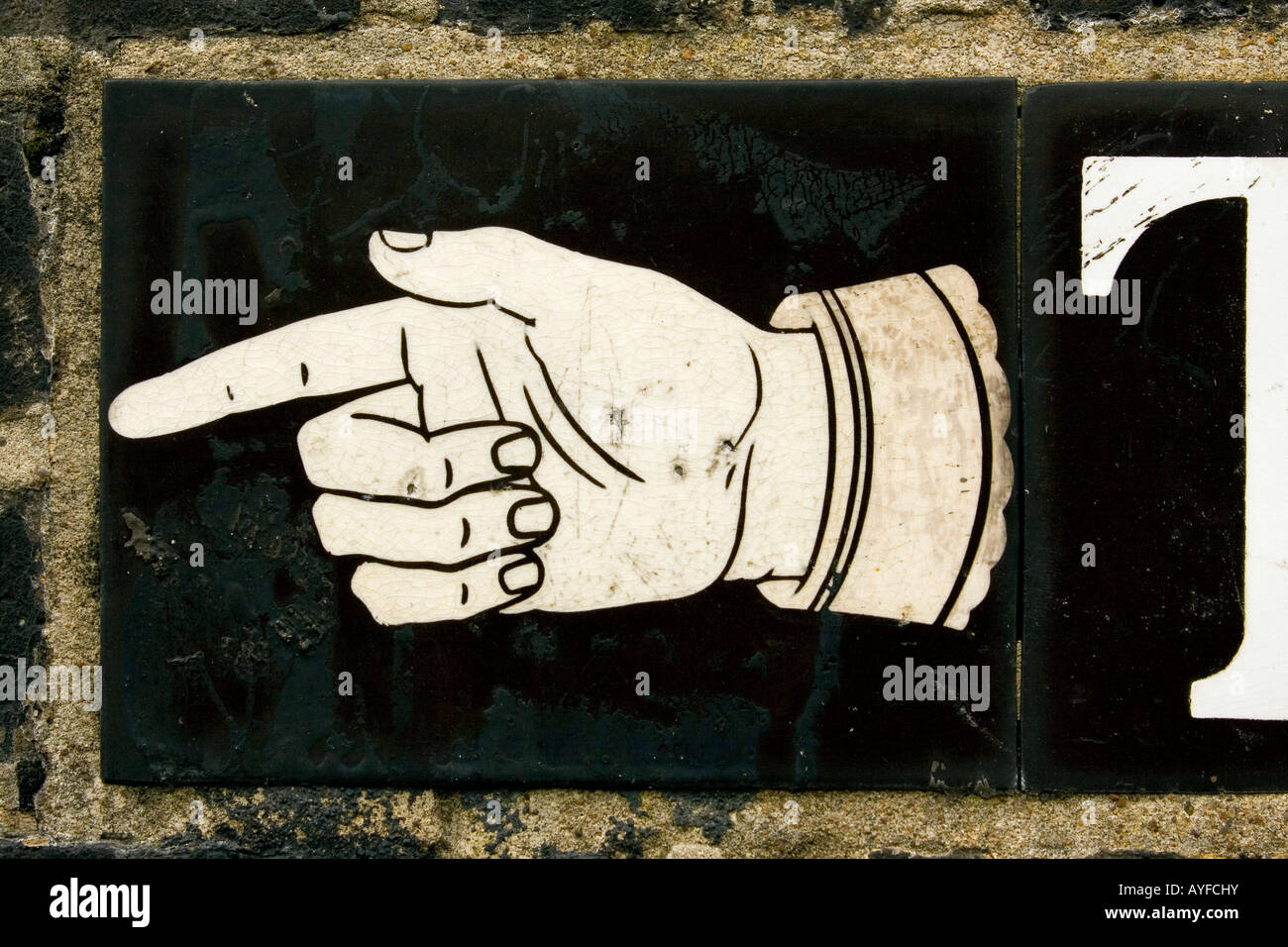A finger pointing TO with hand from street sign Hampstead London England UK Stock Photo