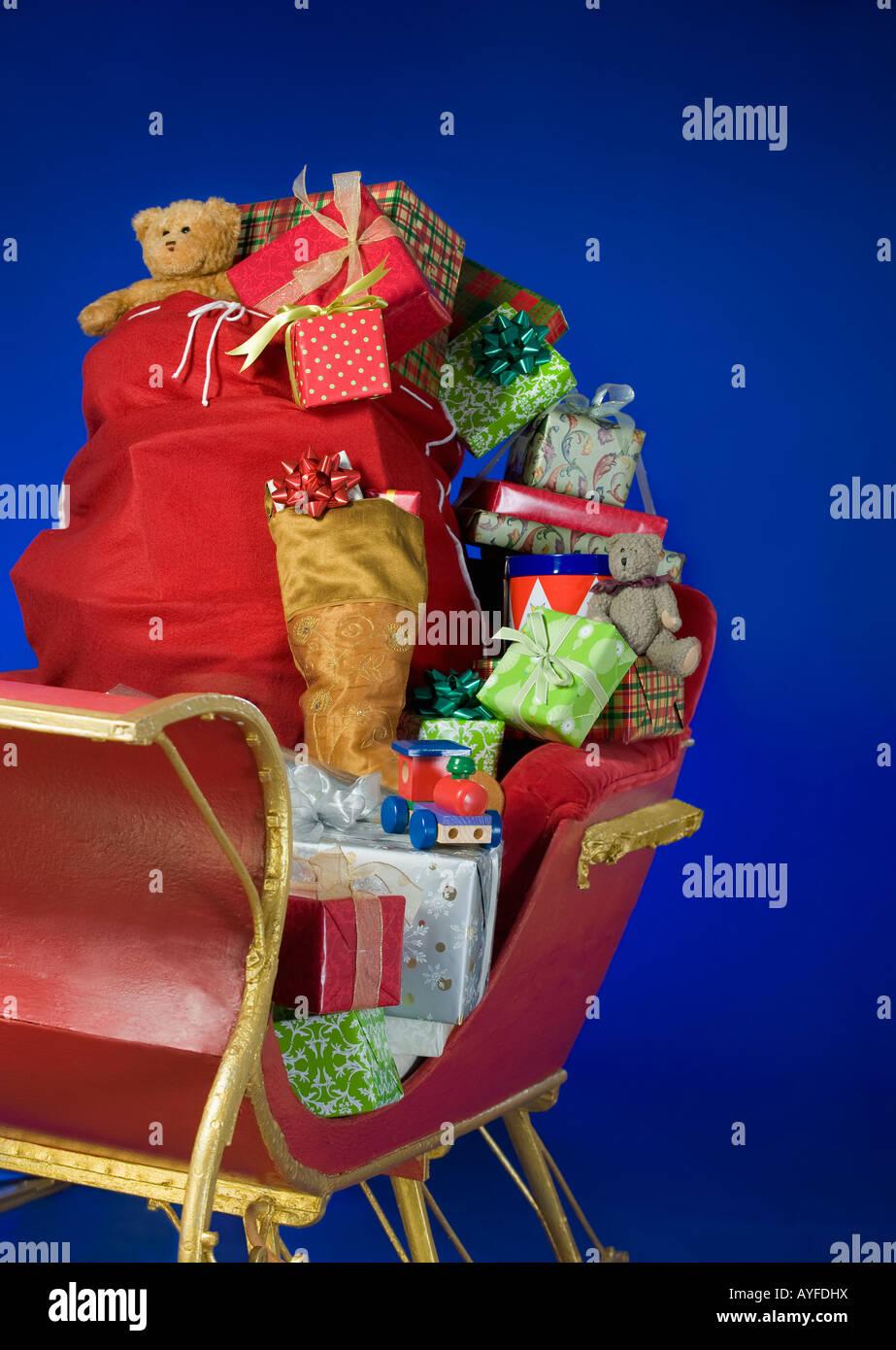 Sleigh with bag of Christmas toys Stock Photo
