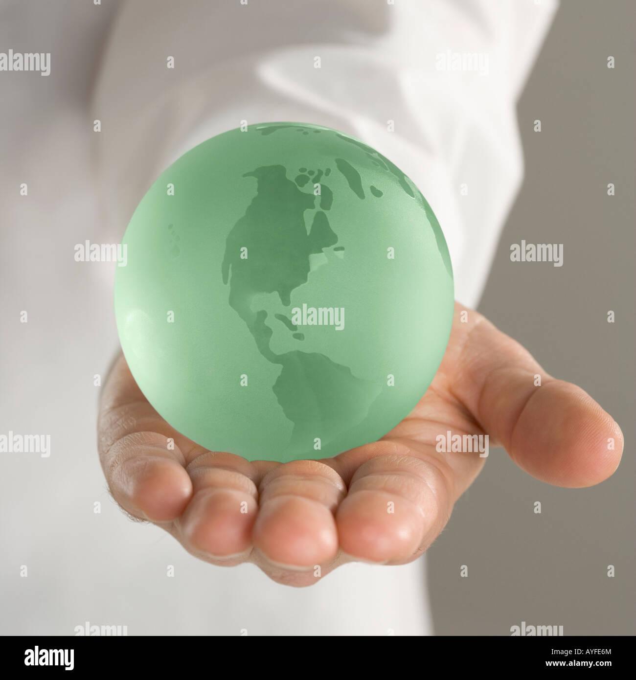 Hand holding globe - Stock Image
