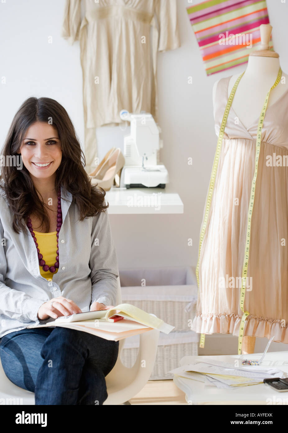 Seamstress in dress shop - Stock Image
