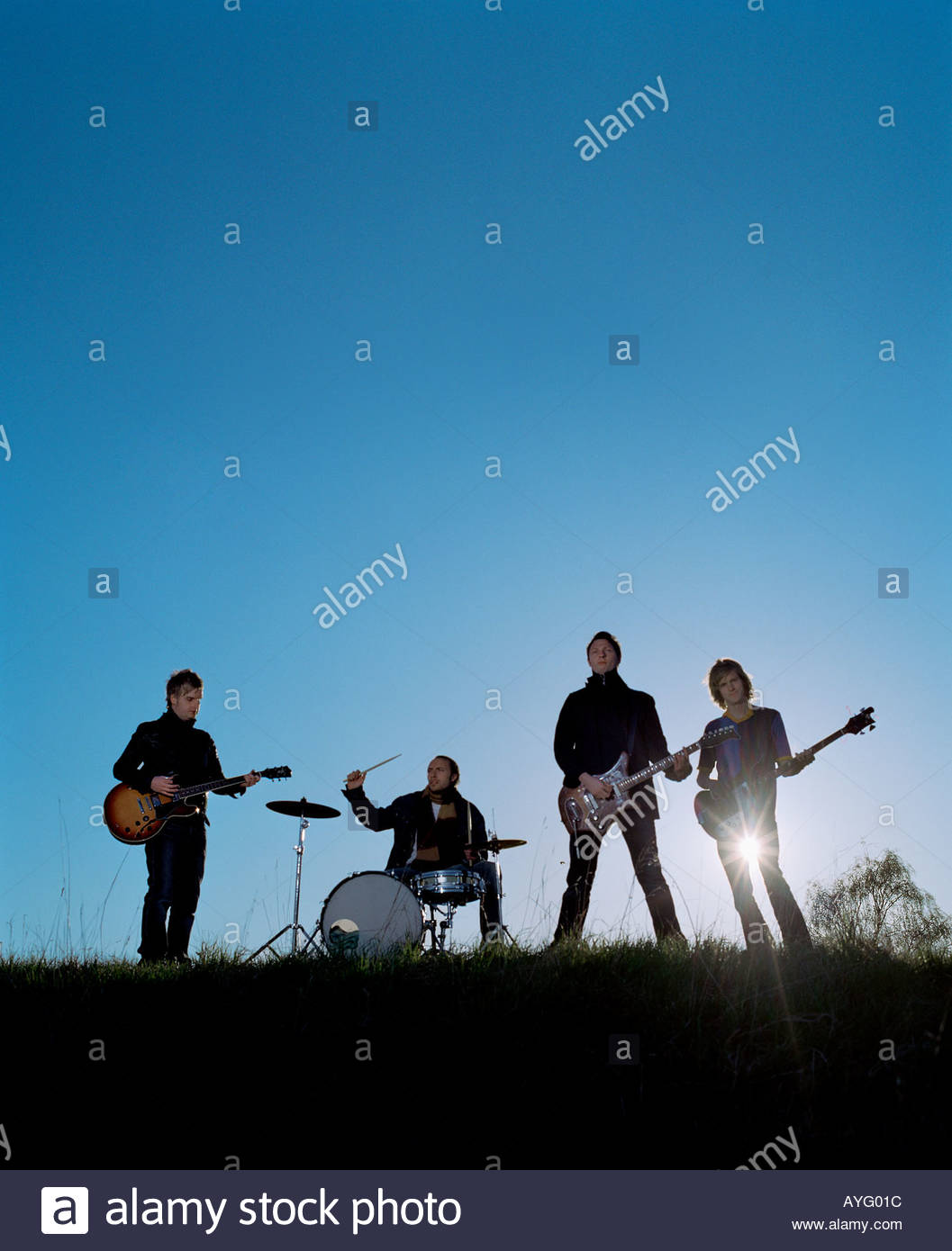 A rock band playing outside - Stock Image