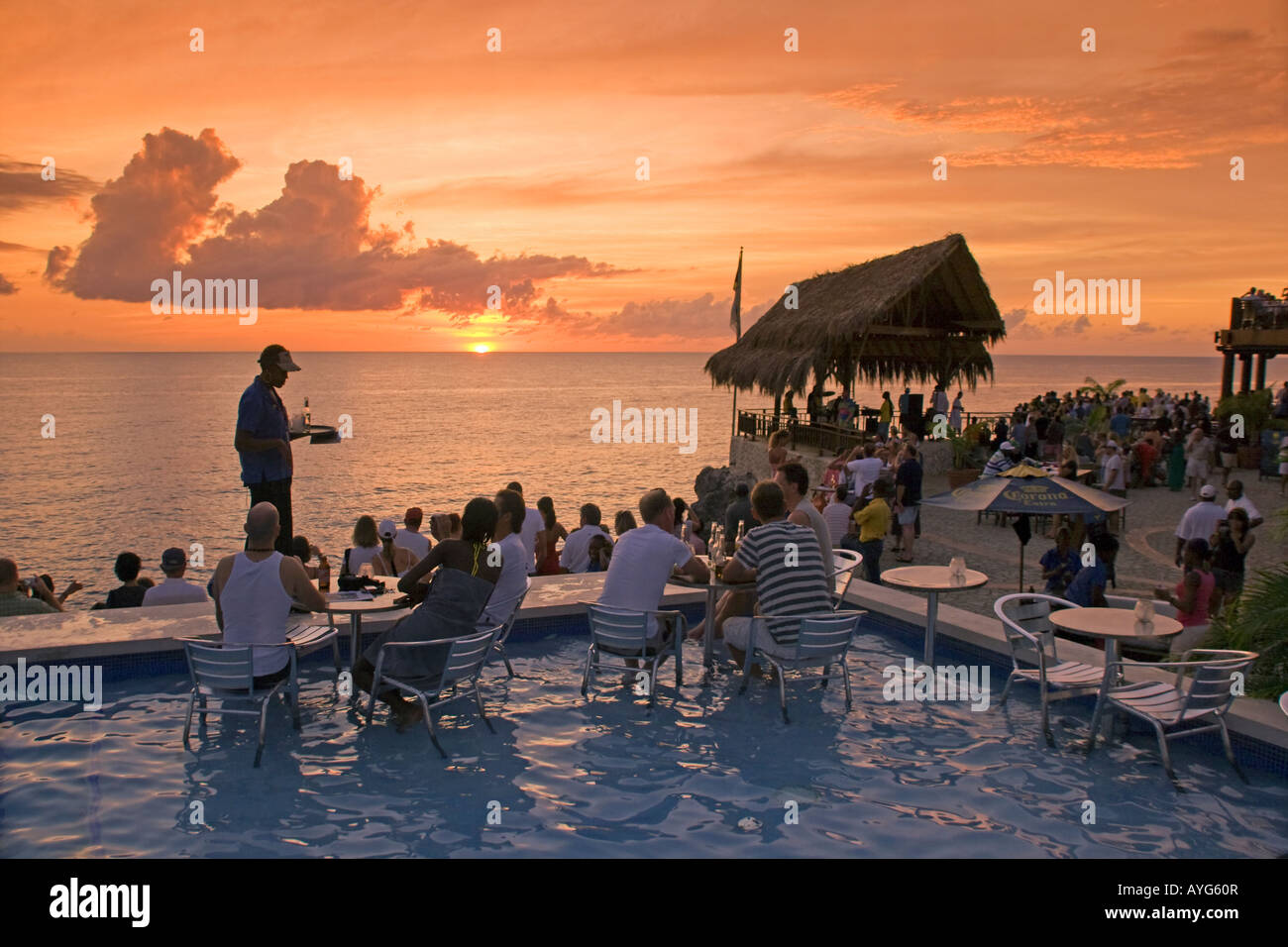 Jamaica Negril Ricks Cafe Open air Pool Bar Viewpoint at Sunset - Stock Image