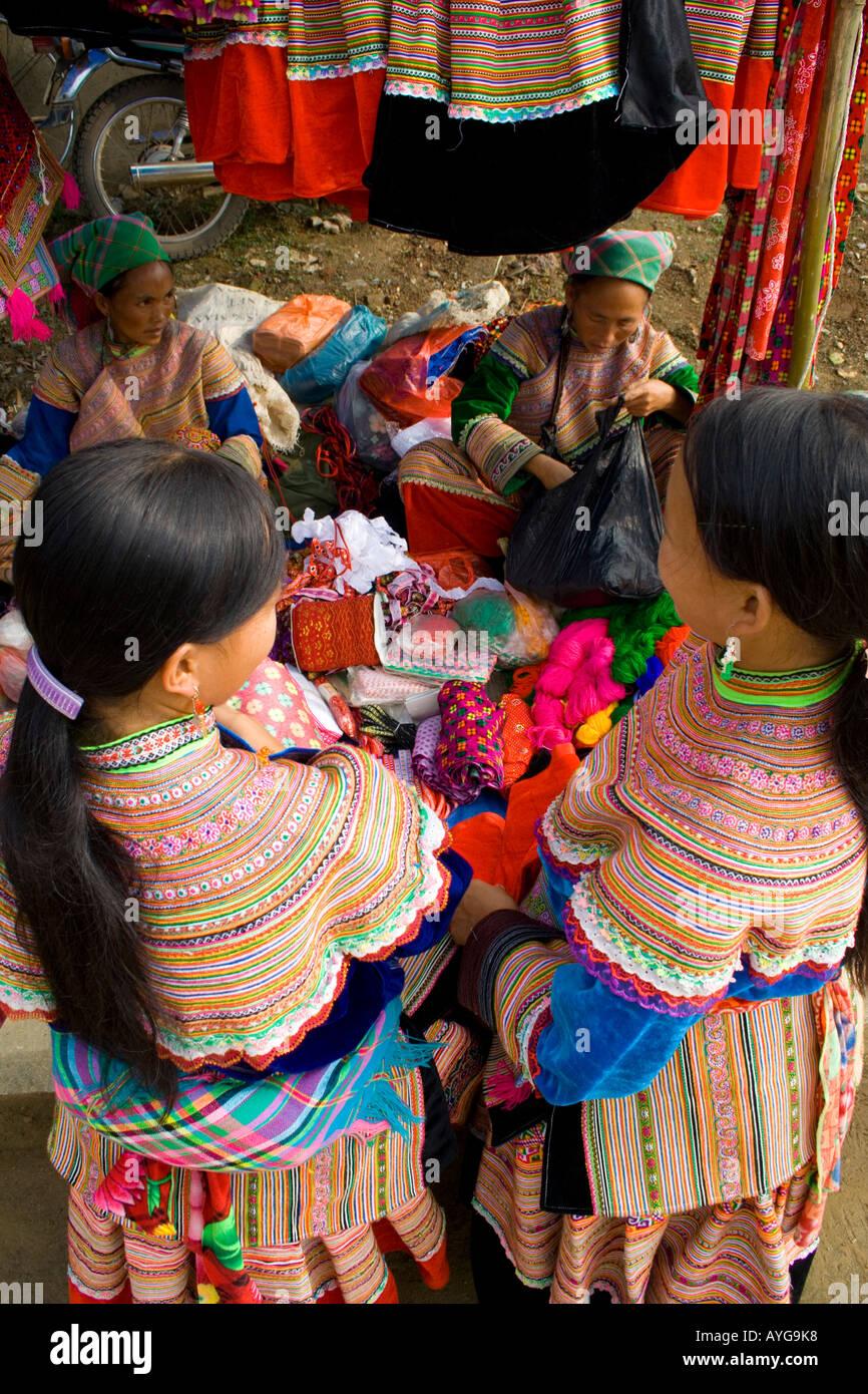 Flower Hmong Women Buy and Sell Colouful Clothing and Fabrics Bac Ha Market near Sapa Vietnam Stock Photo
