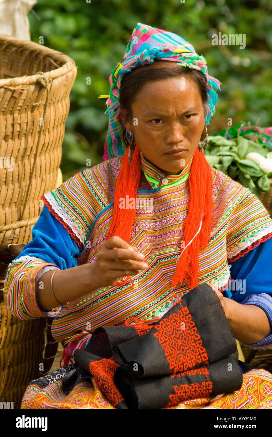 Flower Hmong Women Making Colouful Clothing and Fabrics Bac Ha Market near Sapa Vietnam Stock Photo